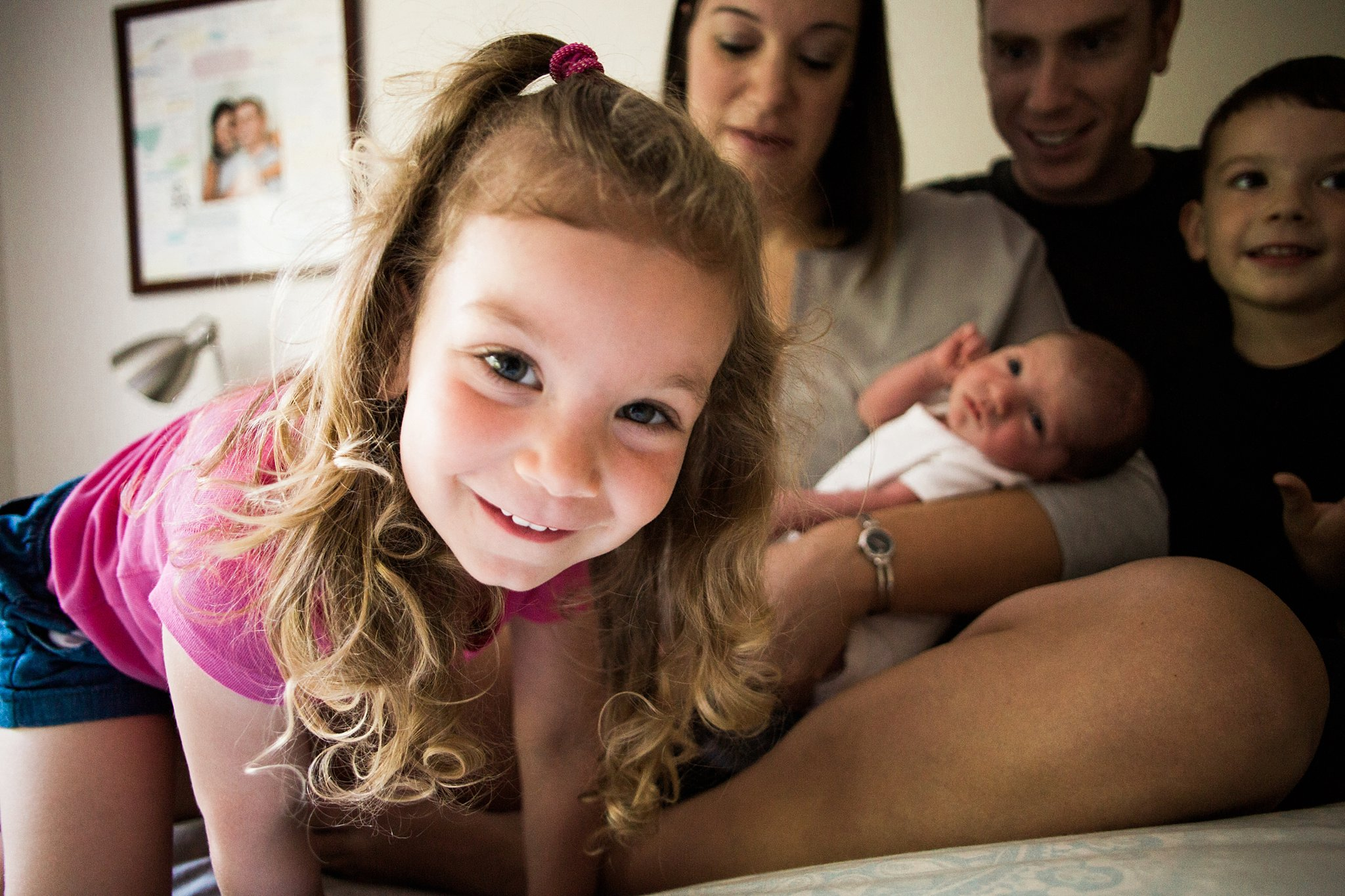 siblings and newborn in home photography