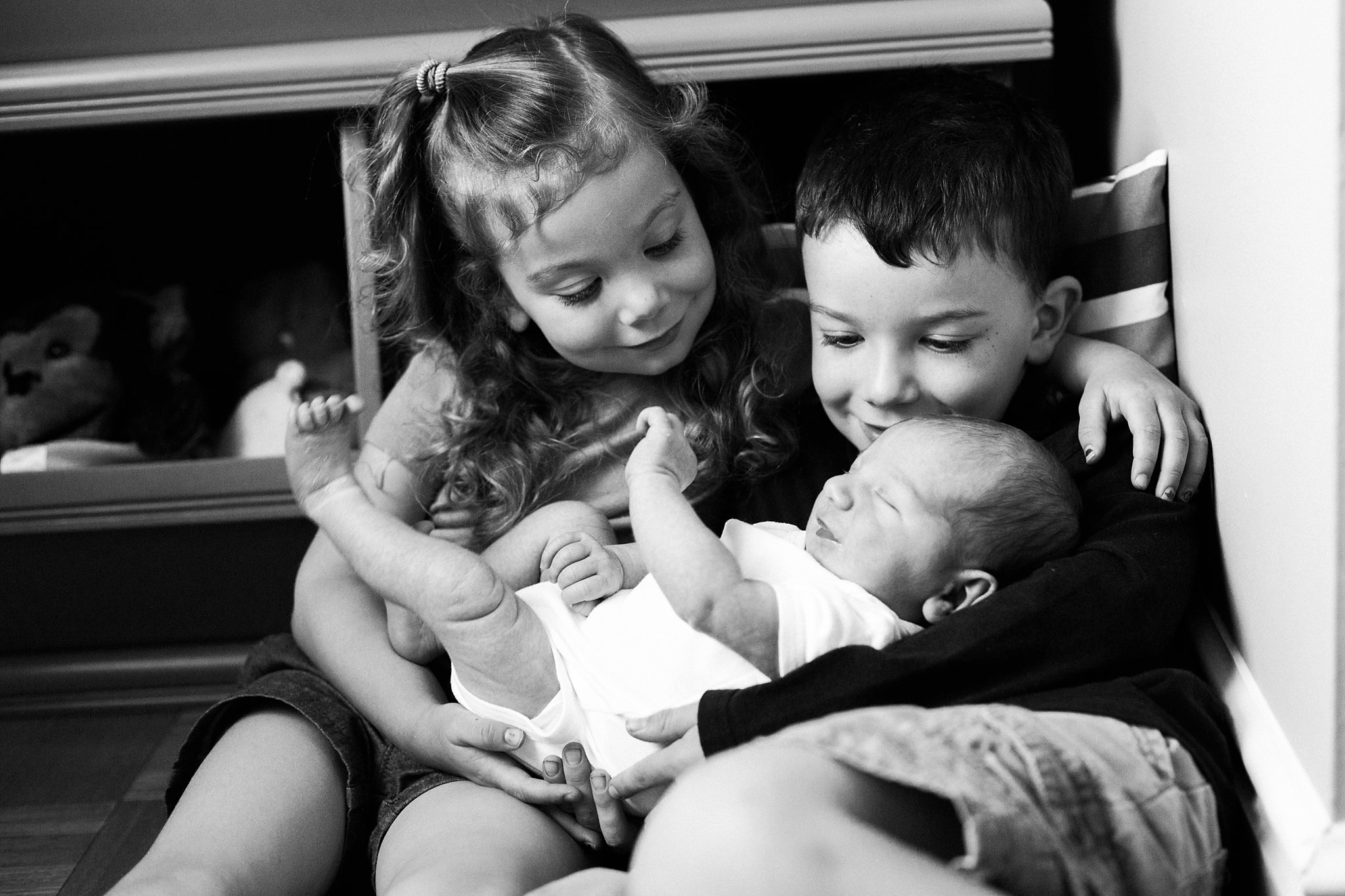 photos of older siblings with new baby brother