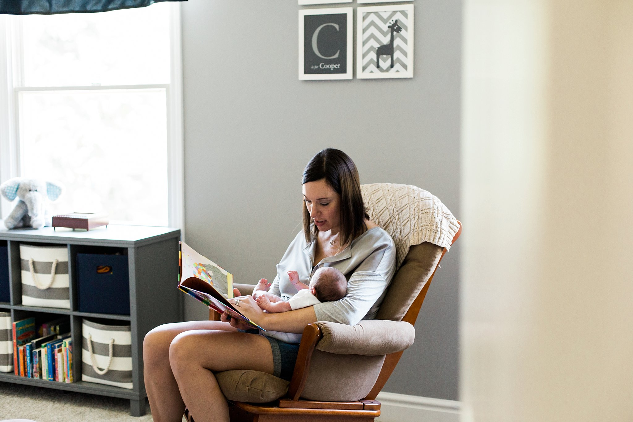 mom reading to newborn baby
