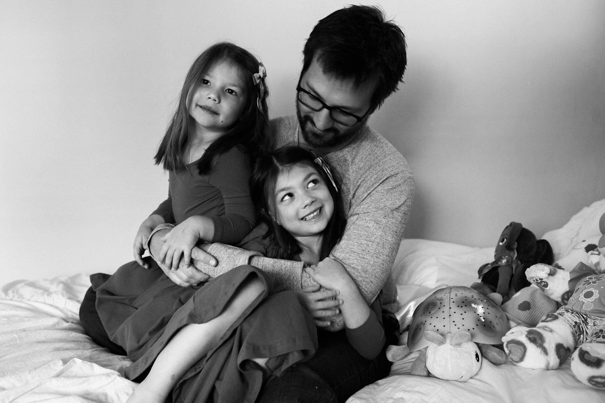 photo of father and daughters at home in pittsburgh pa