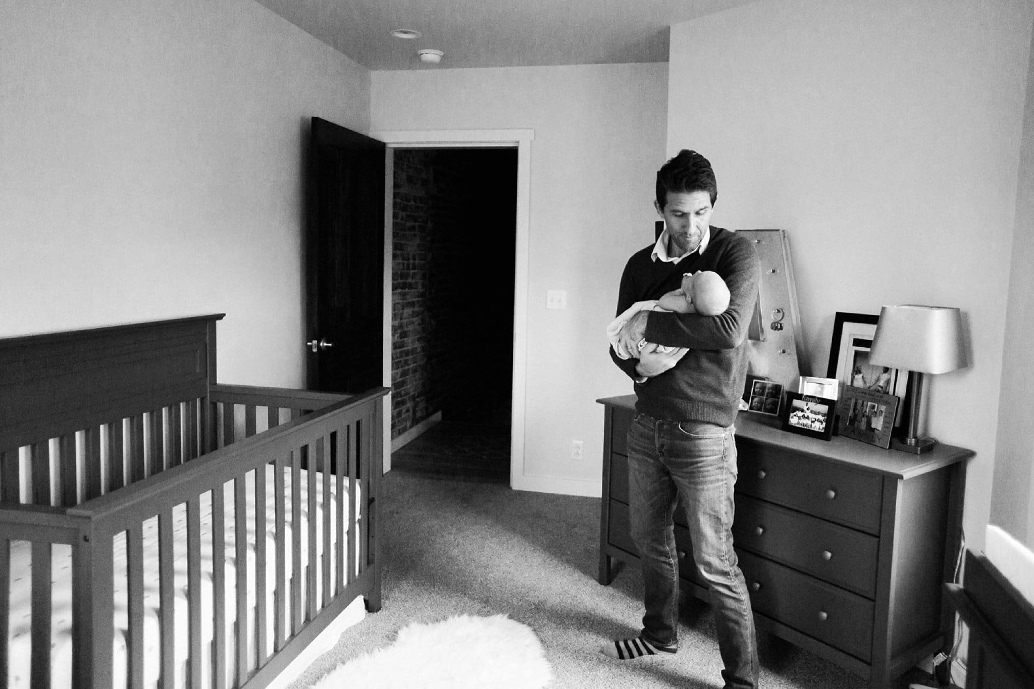photo of father and newborn in nursery in pittsburgh
