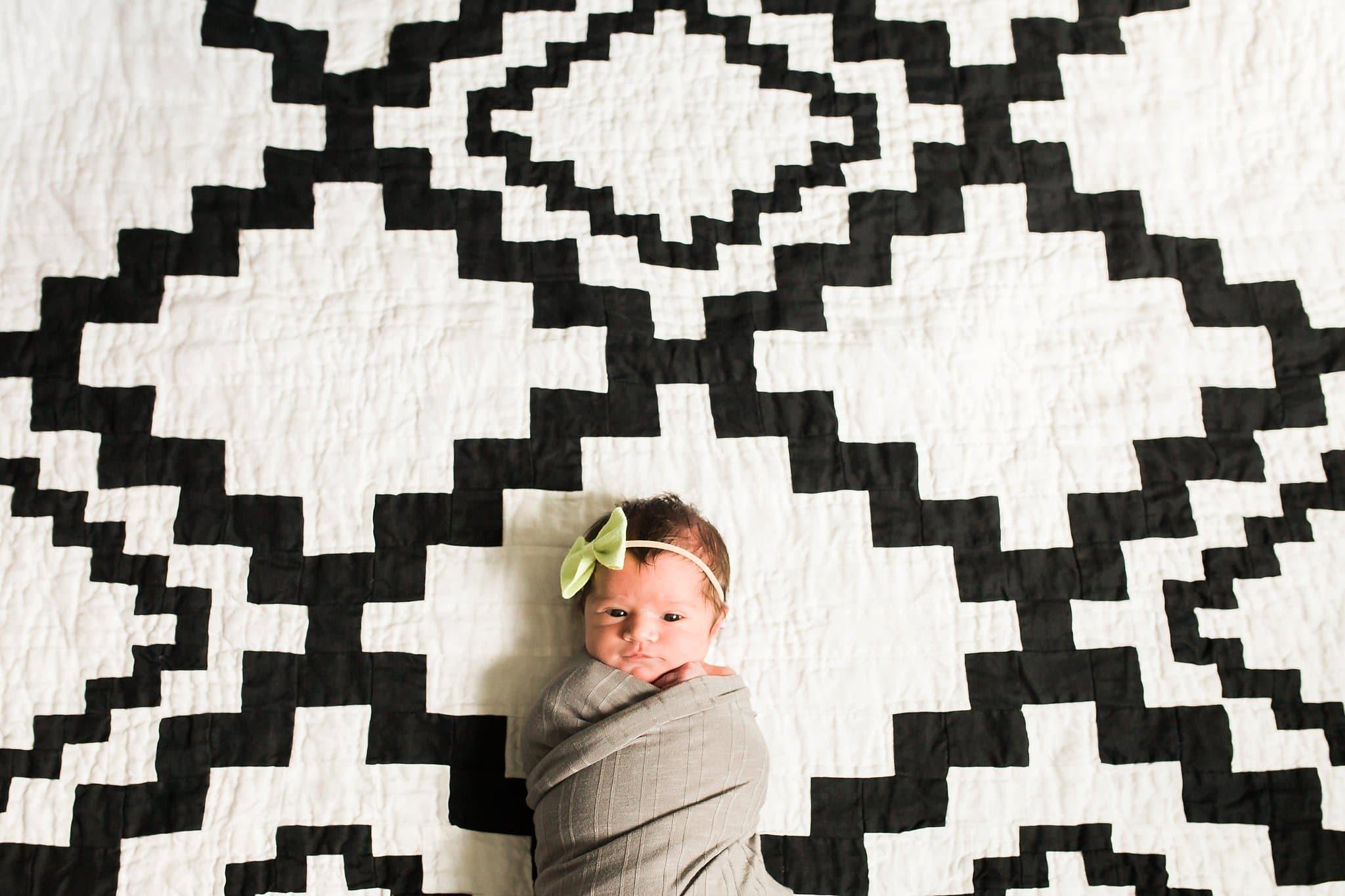 Newborn on graphic print blanket