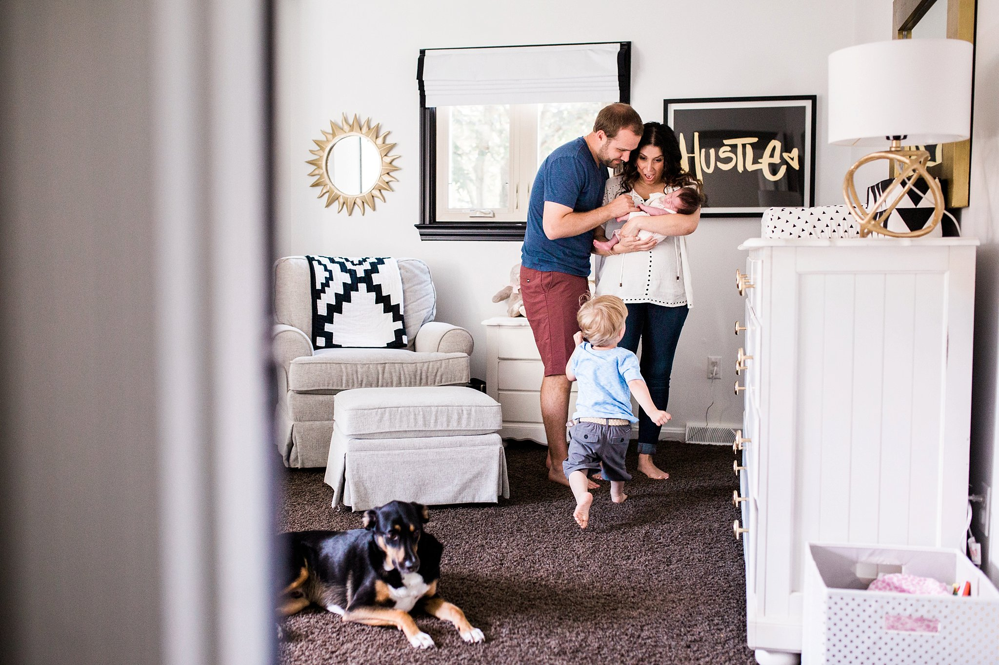 lifestyle family photos in beautiful nursery