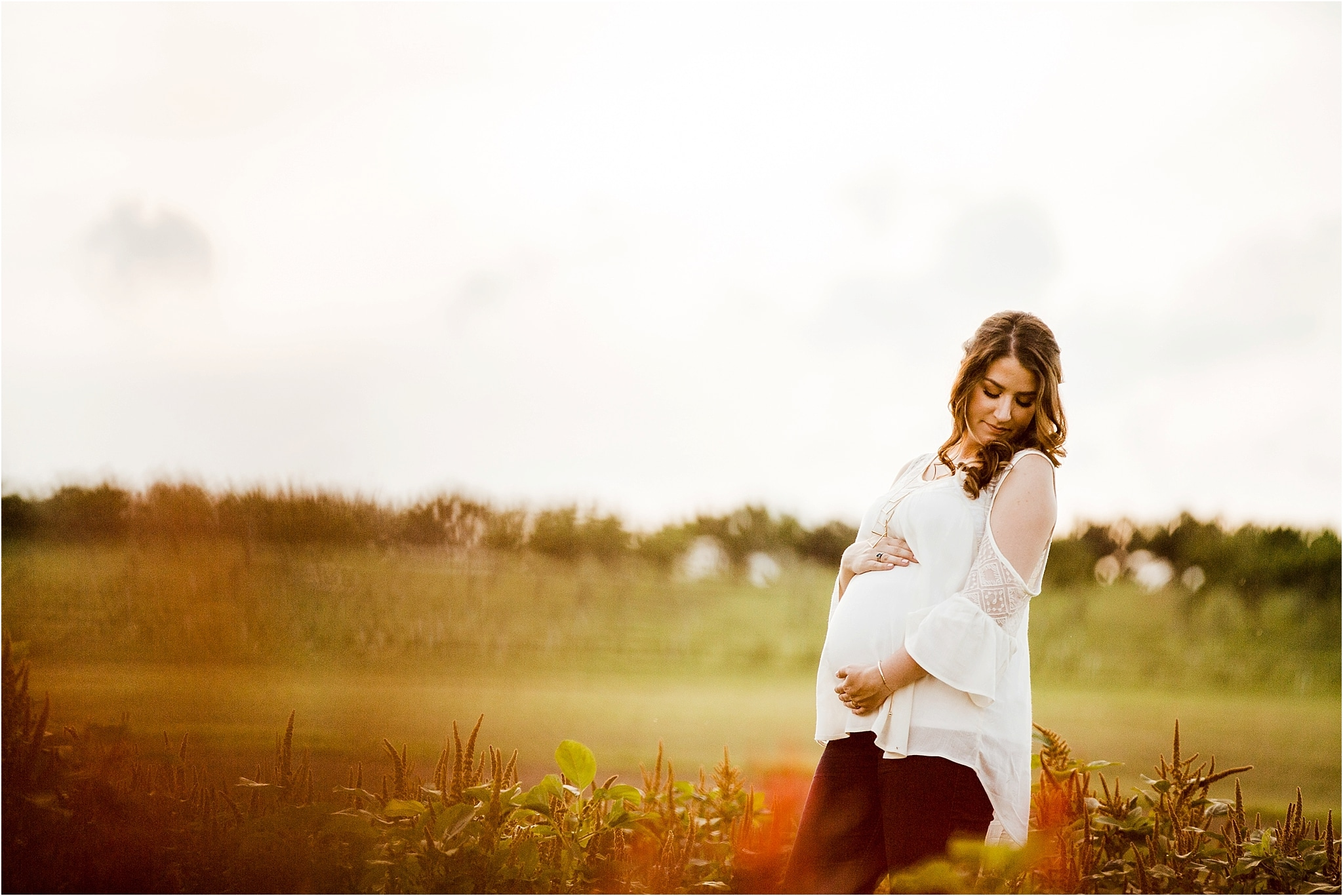 Maternity photos in flower field at Simmons Farm