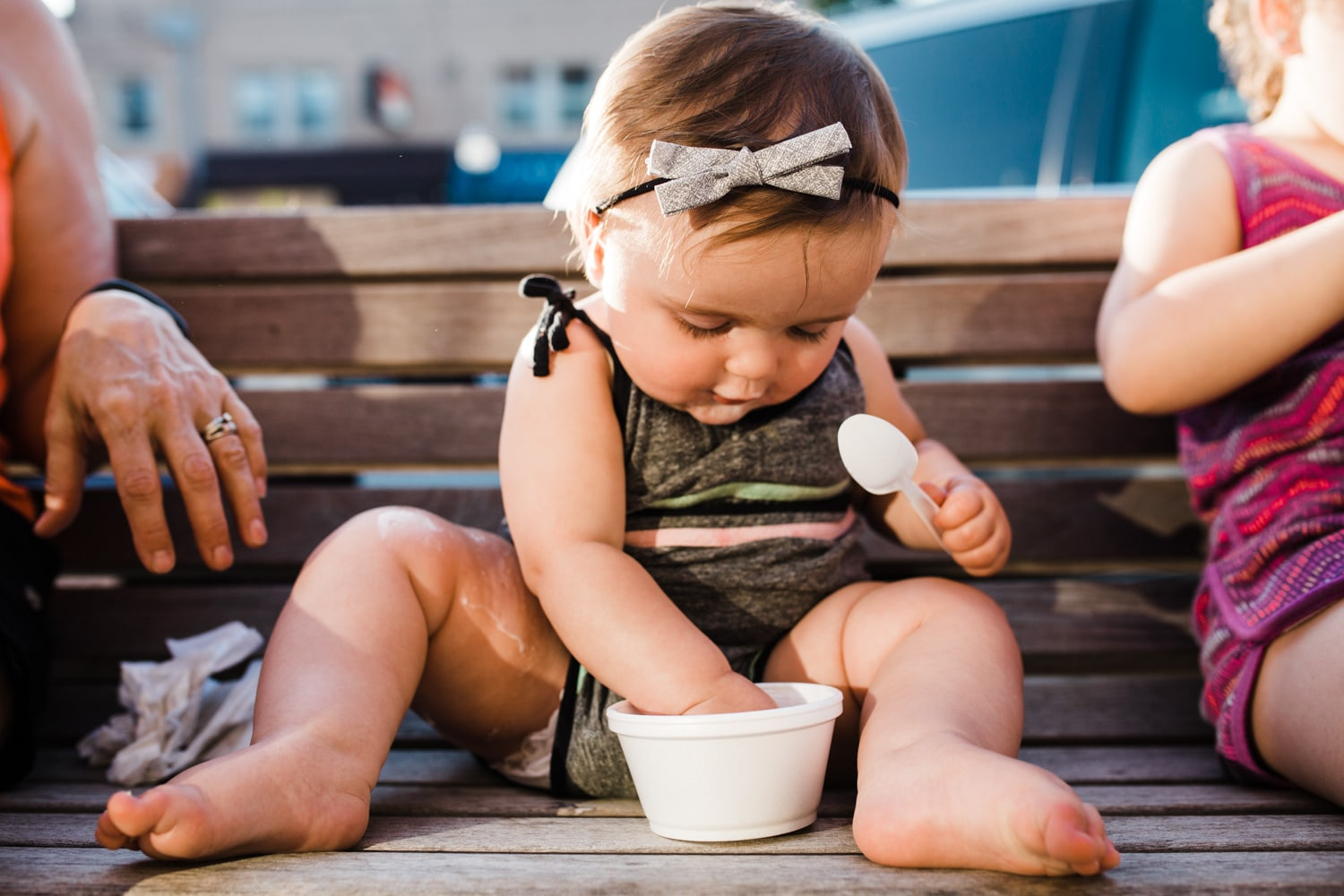 baby girl eating ice cream in adorable romper