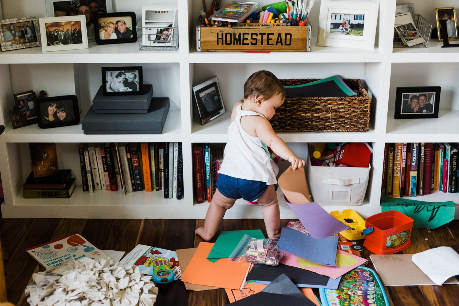11 month ols girl making a mess of home living room