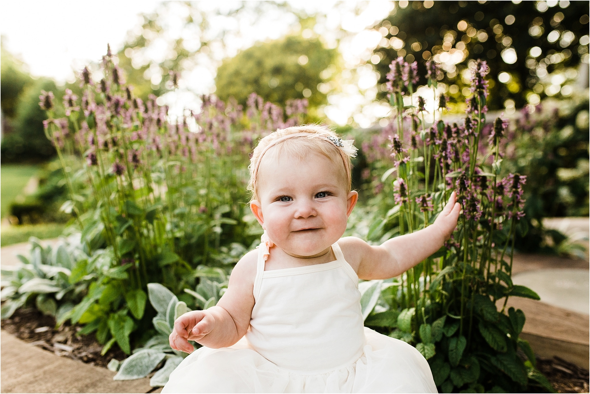 one year old baby girl photo in flowers