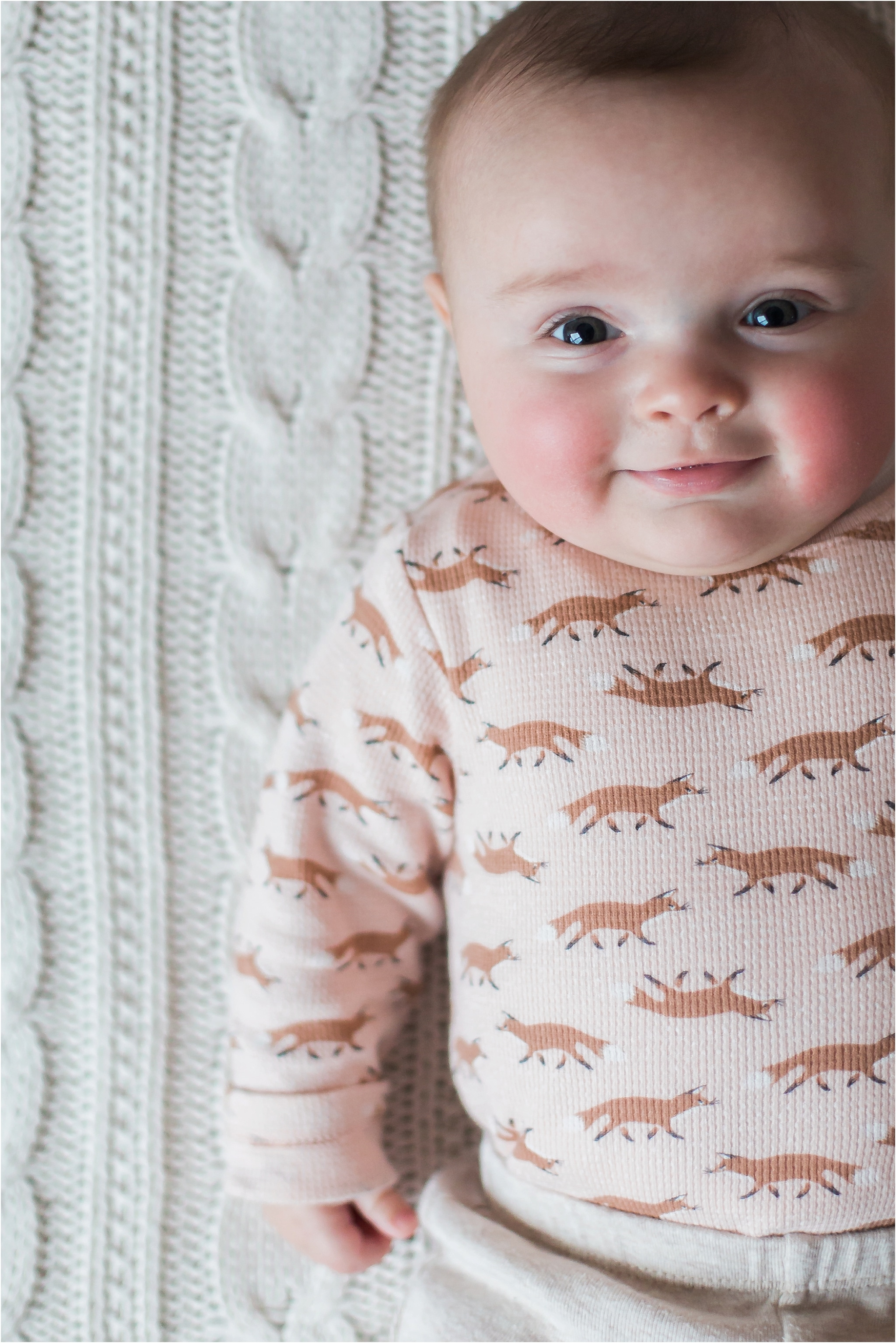 four month old baby girl photo on pottery barn cable knit blanket