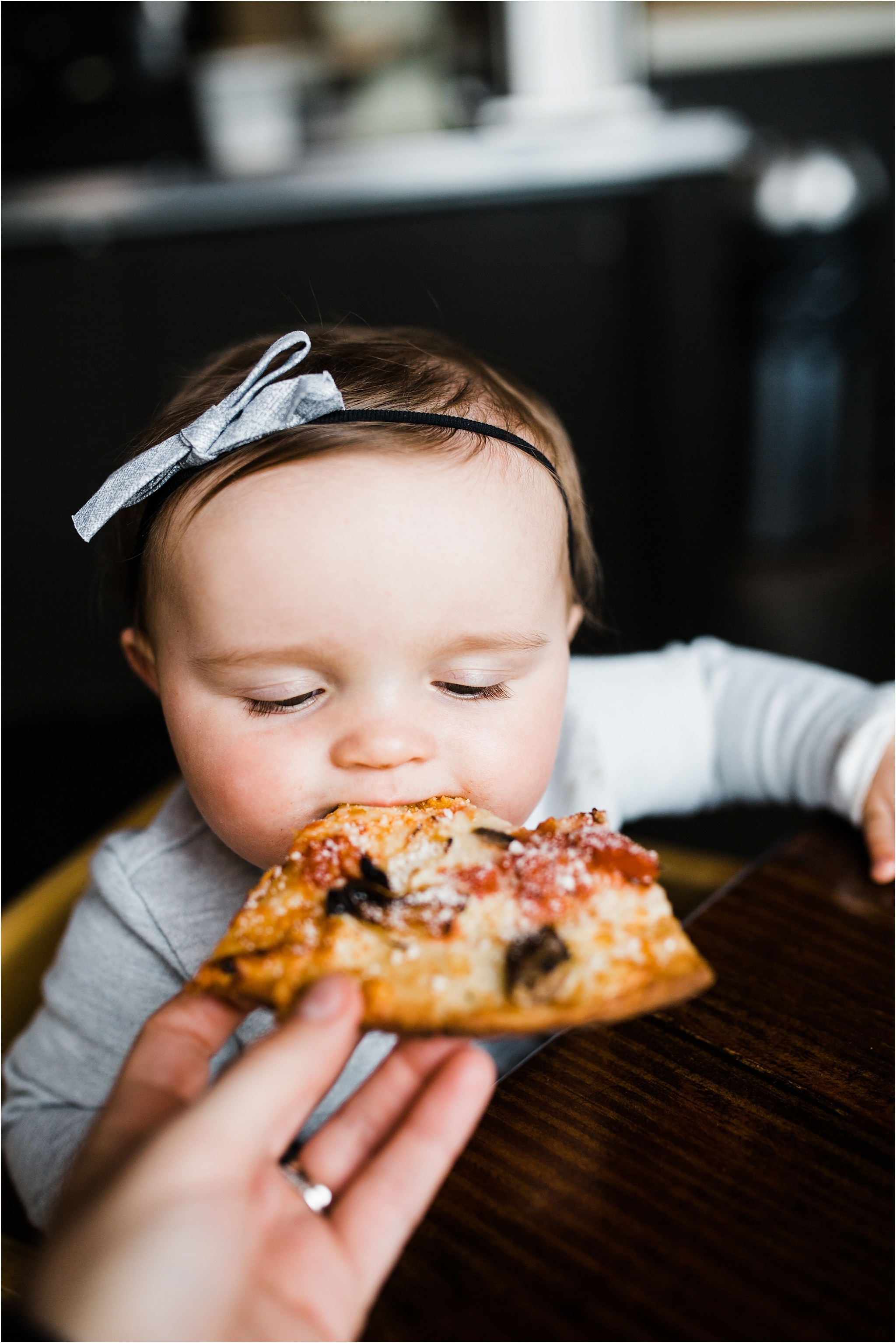 9 month old eating pizza for the first time