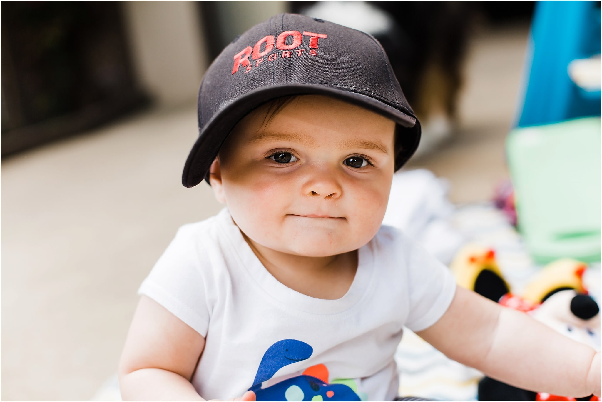 baby girl in daddys hat