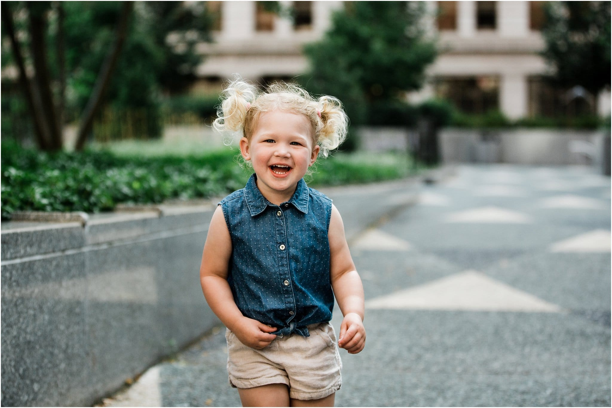toddler girl smiling downtown pittsburgh