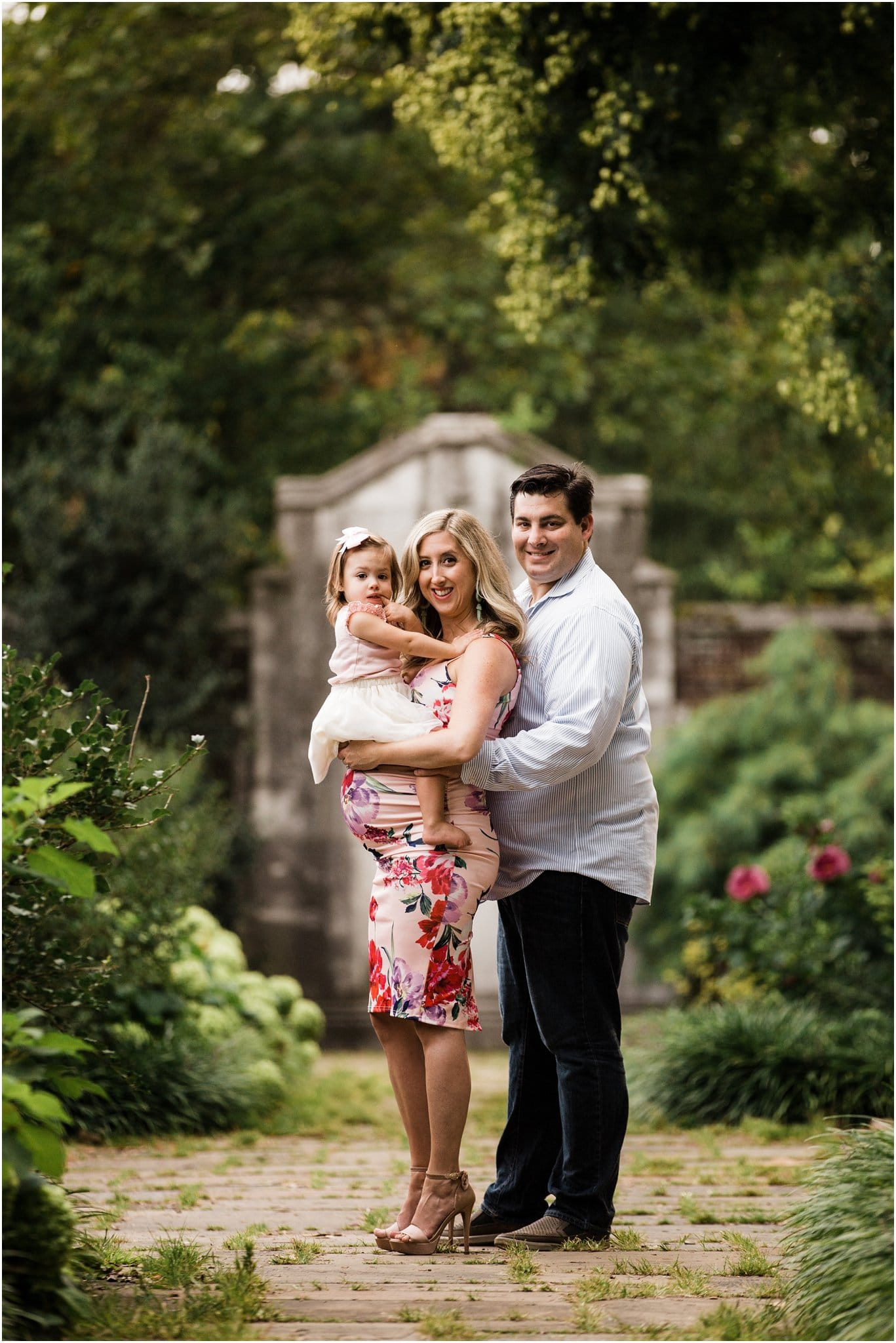 family maternity photo in walled garden
