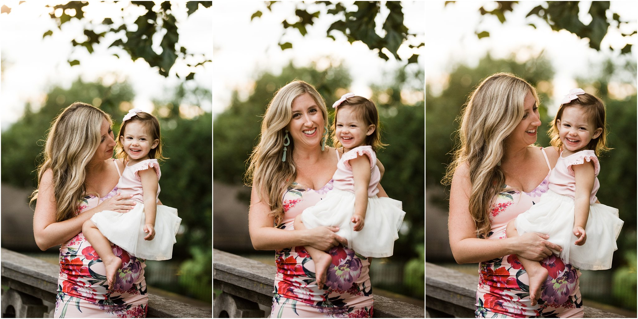 gorgeous mother in form fitting ASOS floral maternity dress with daughter