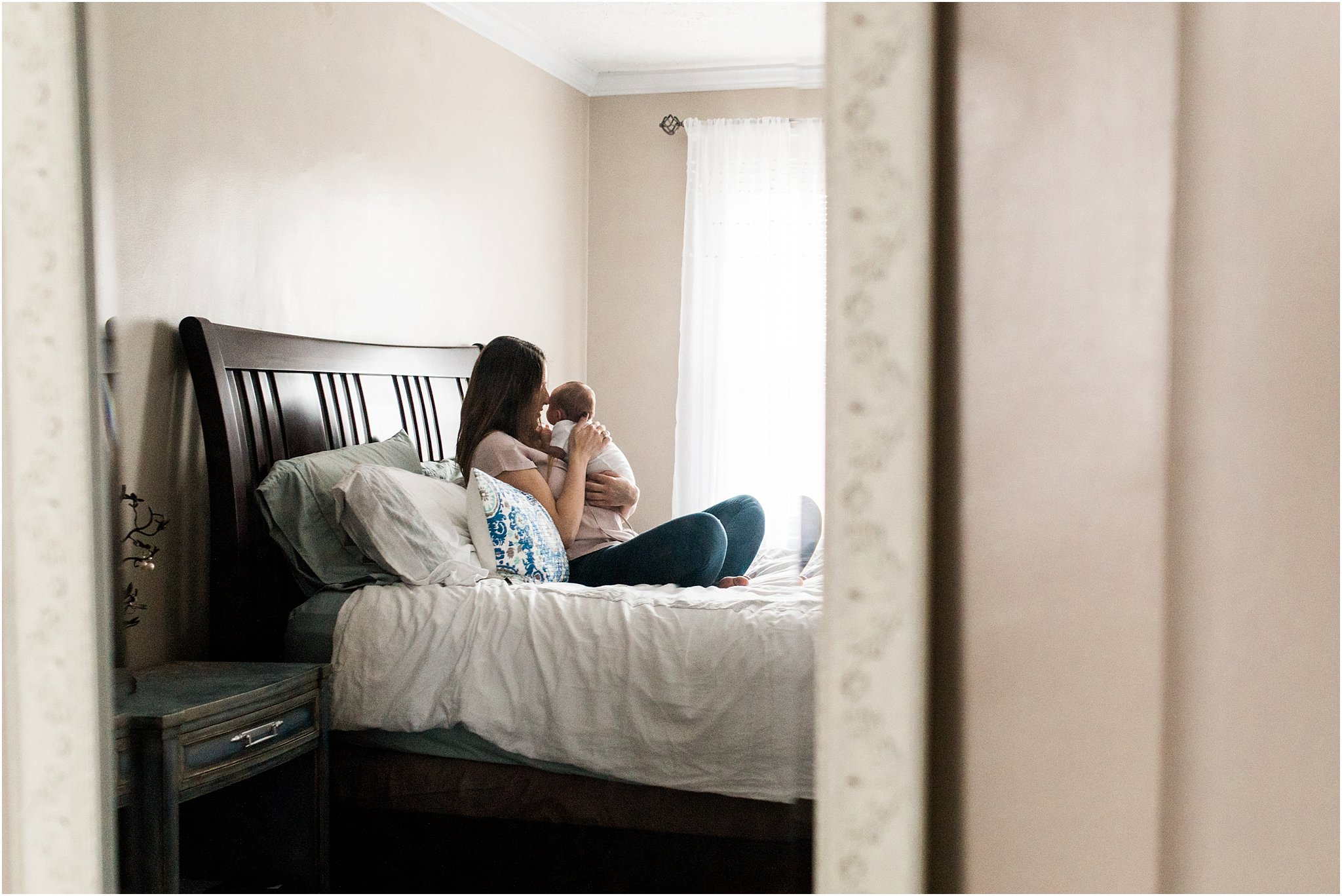 photo of new mom and baby spending quiet moment together in bedroom