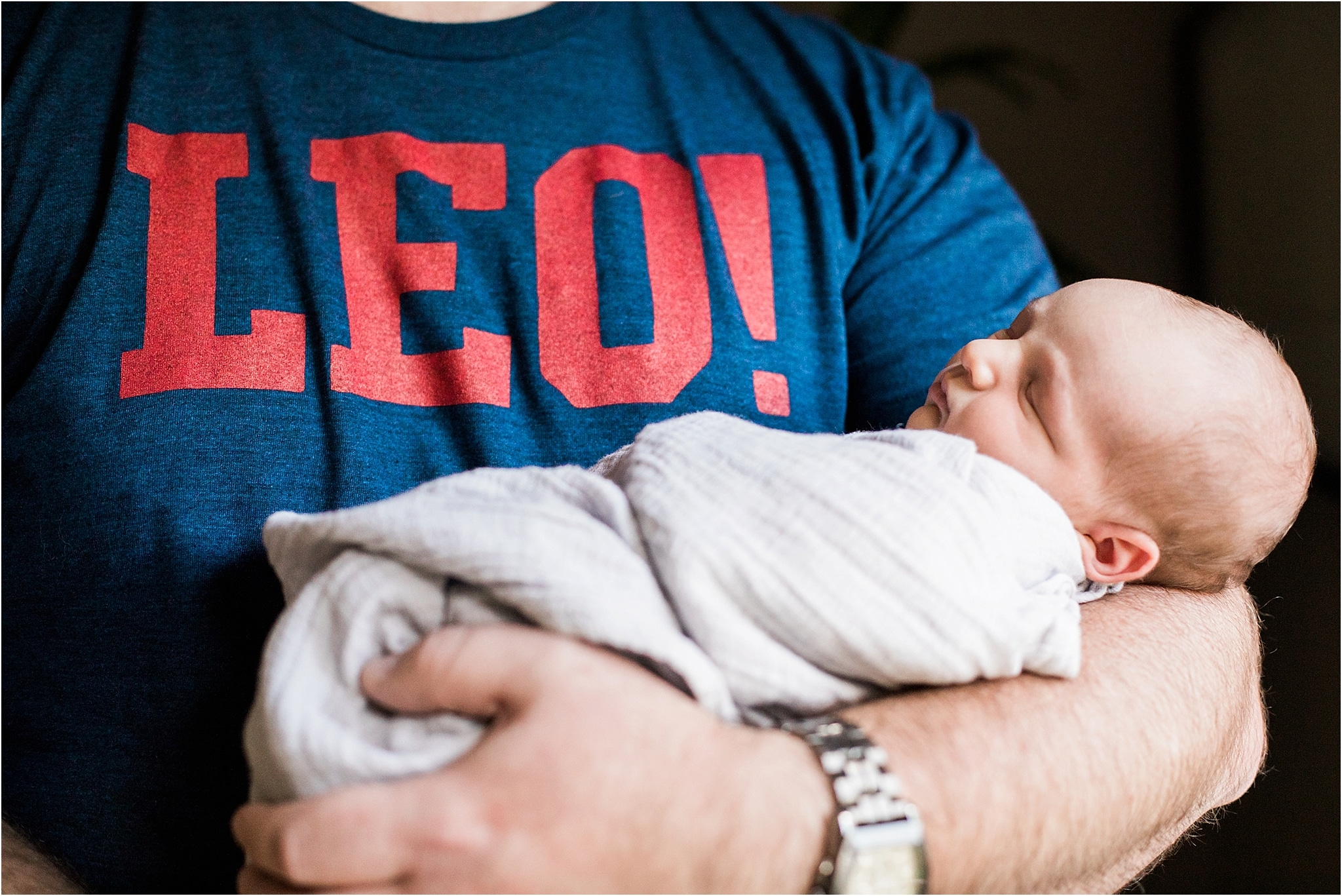 fathers arms holding newborn