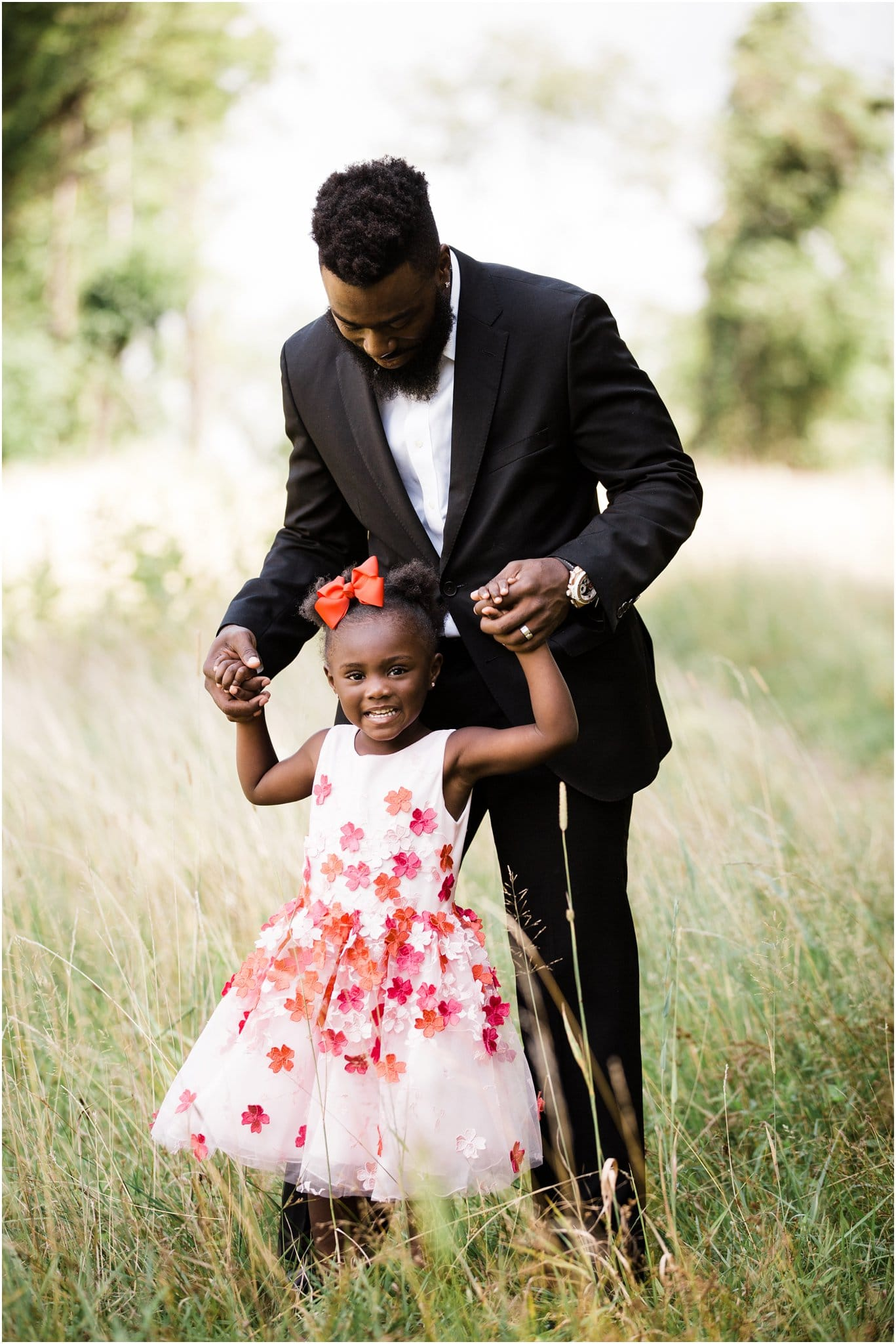 glam daddy and daughter maternity photos with red dresses