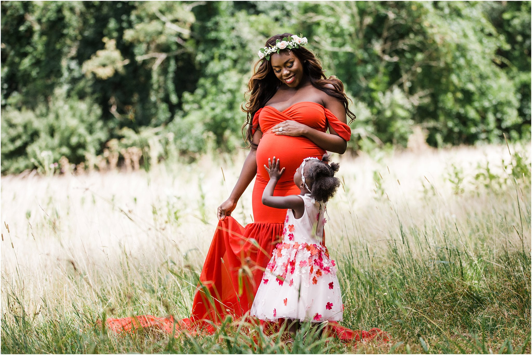 glam mommy and daughter maternity photos with red dresses