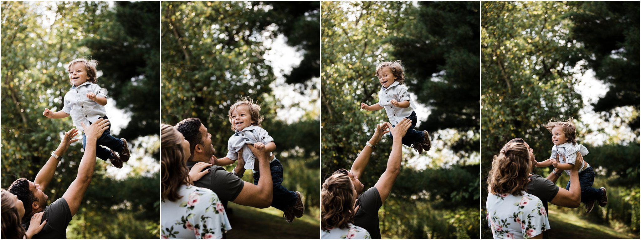 dad tossing laughing toddler boy into the air