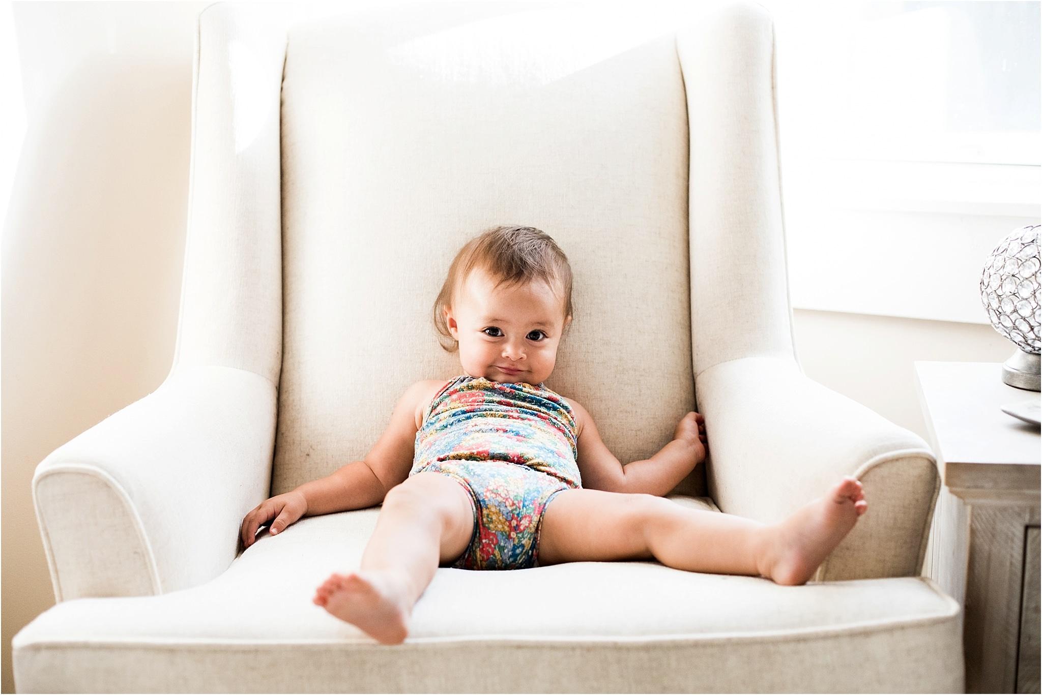 baby girl slouching in nursery chair