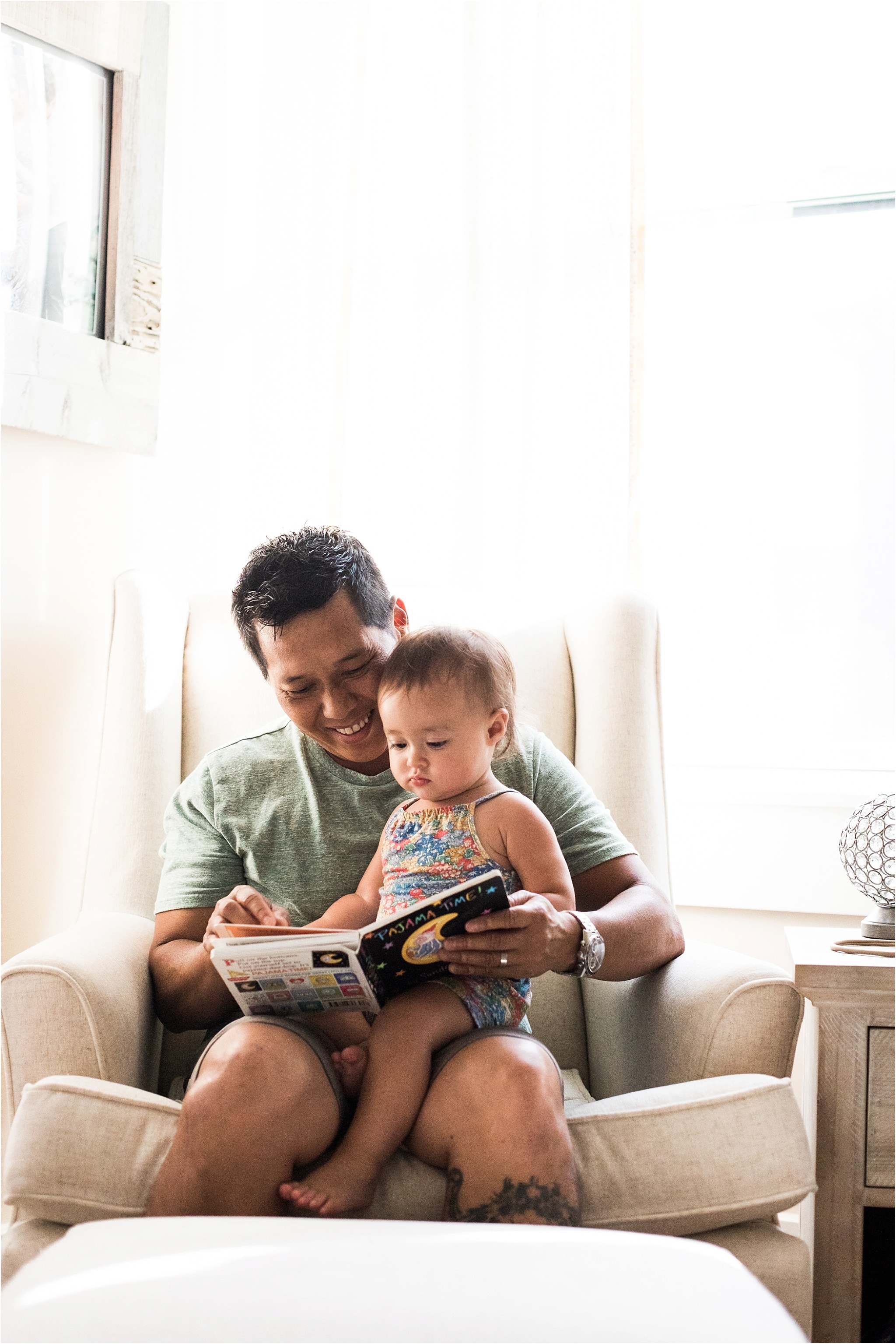 father reading a book to baby girl