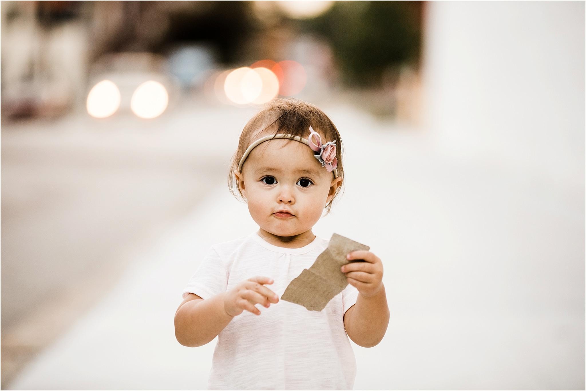 baby girl walking city sidewalks in lawrenceville pittsburgh