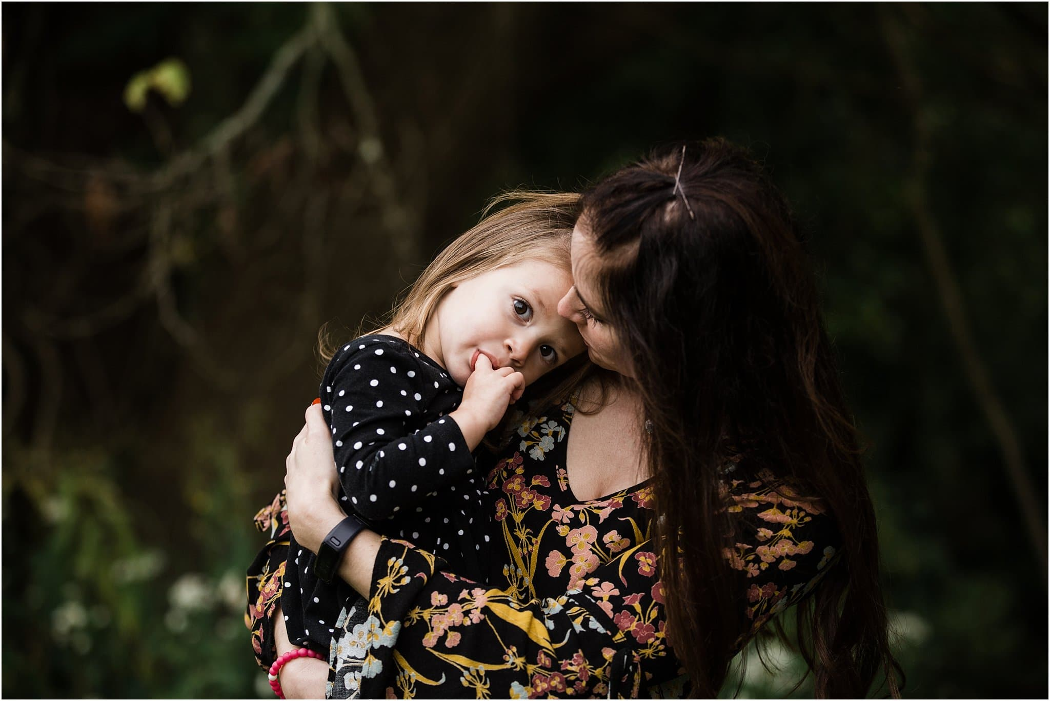 daughter resting in mothers arms