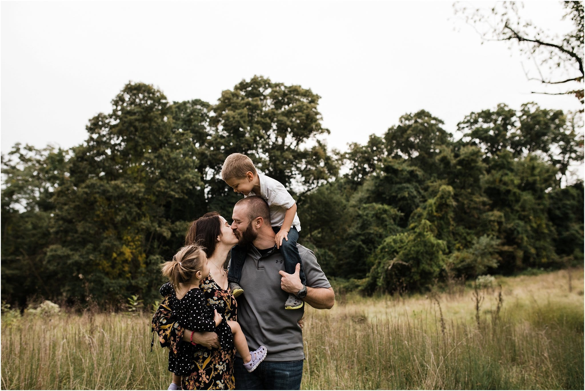 children watching mother and father kiss