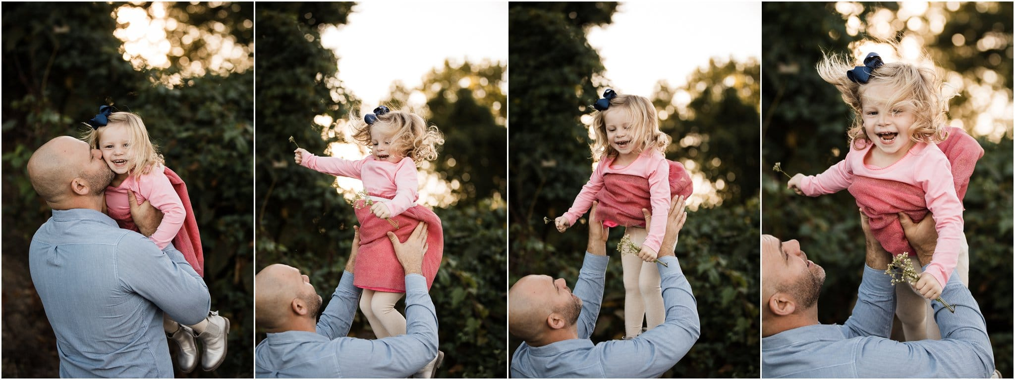 Dad tossing daughter in the air and laughing