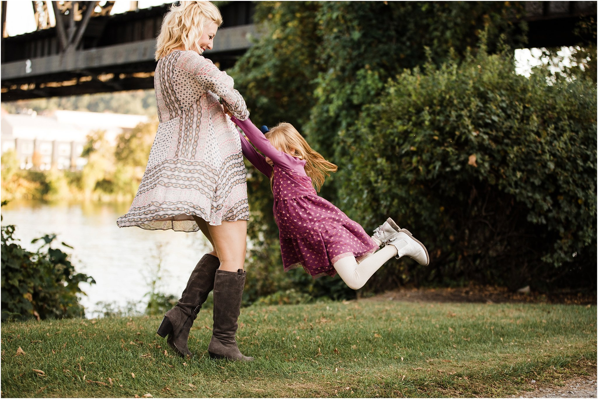 mother swinging daughter in the air