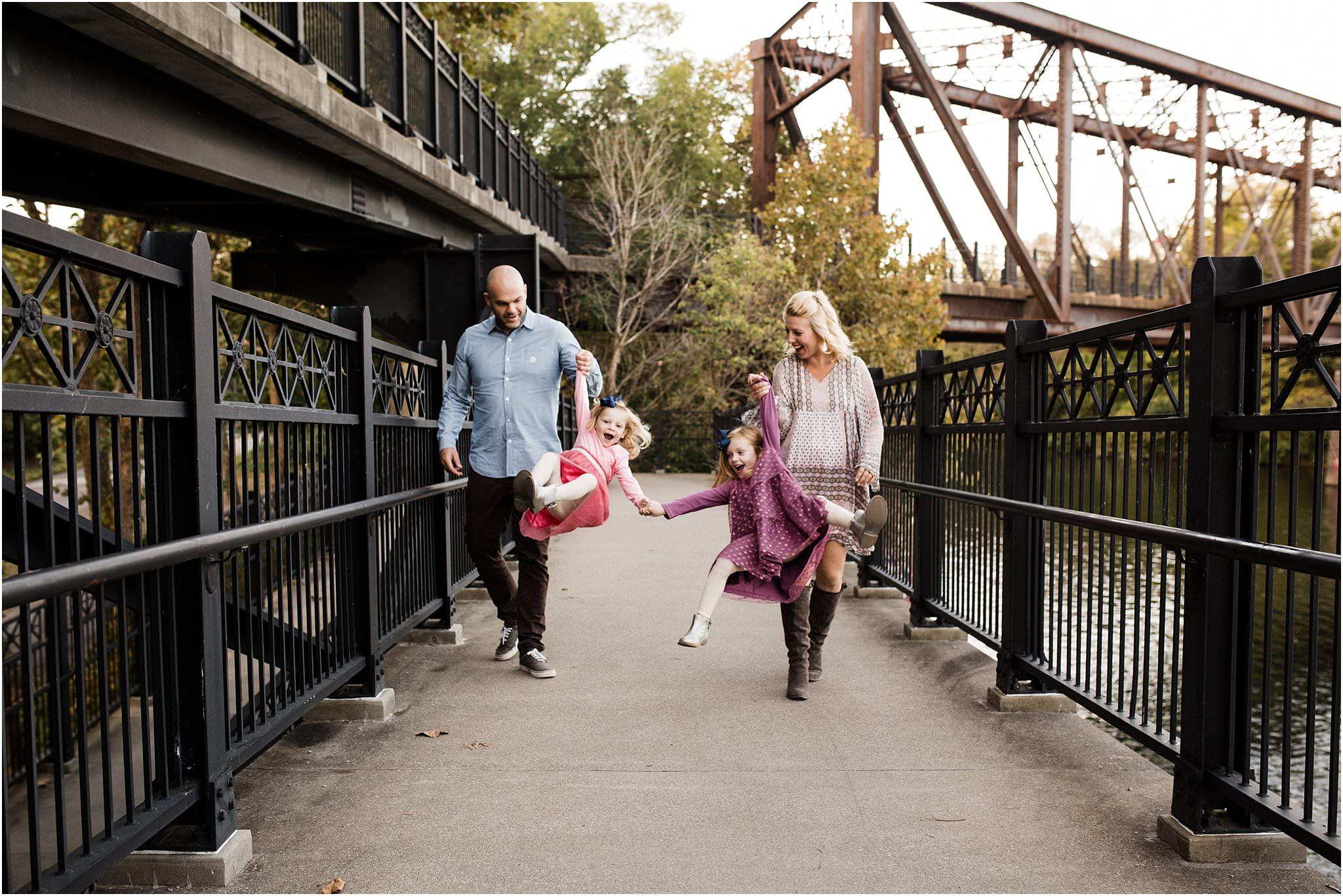 family waling on bridge at Washington's Landing