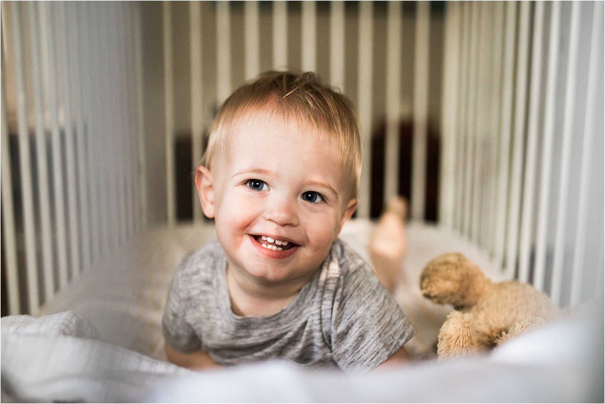 smiling toddler in crib