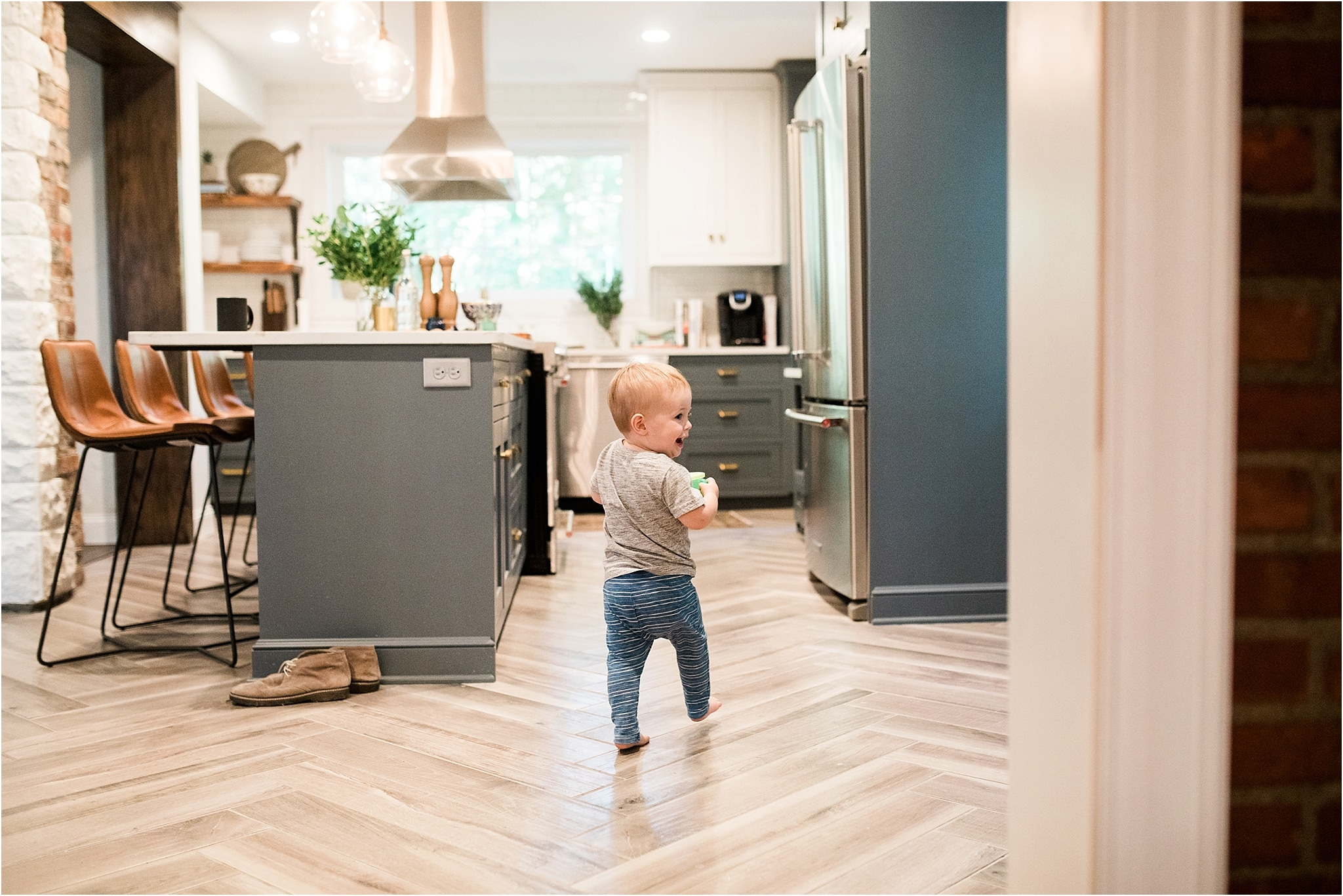 toddler walking through family kitchen
