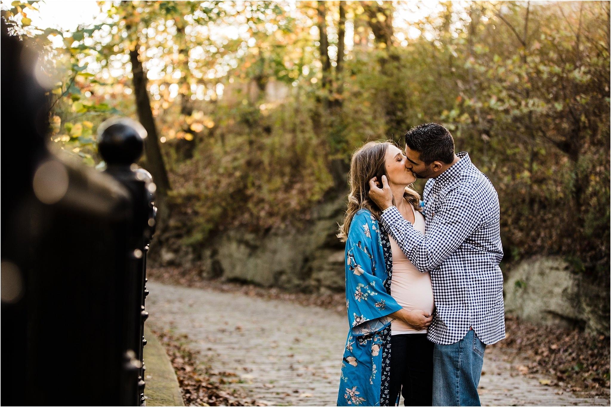 Husband kissing wife maternity photo