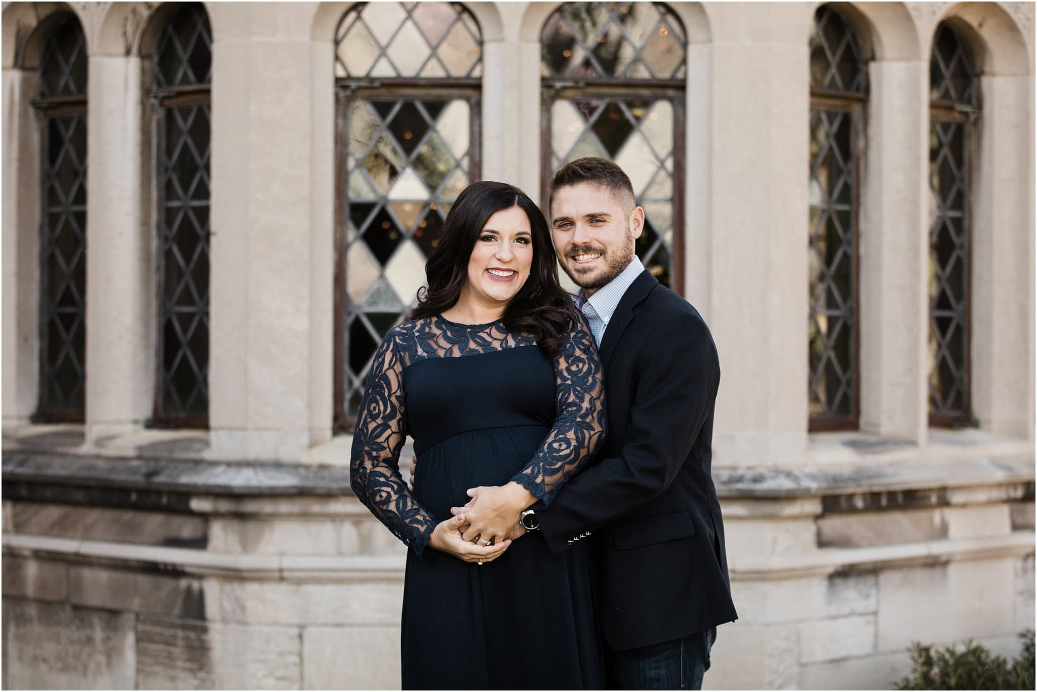 beautiful expecting mother in blue lace maternity dress with husband