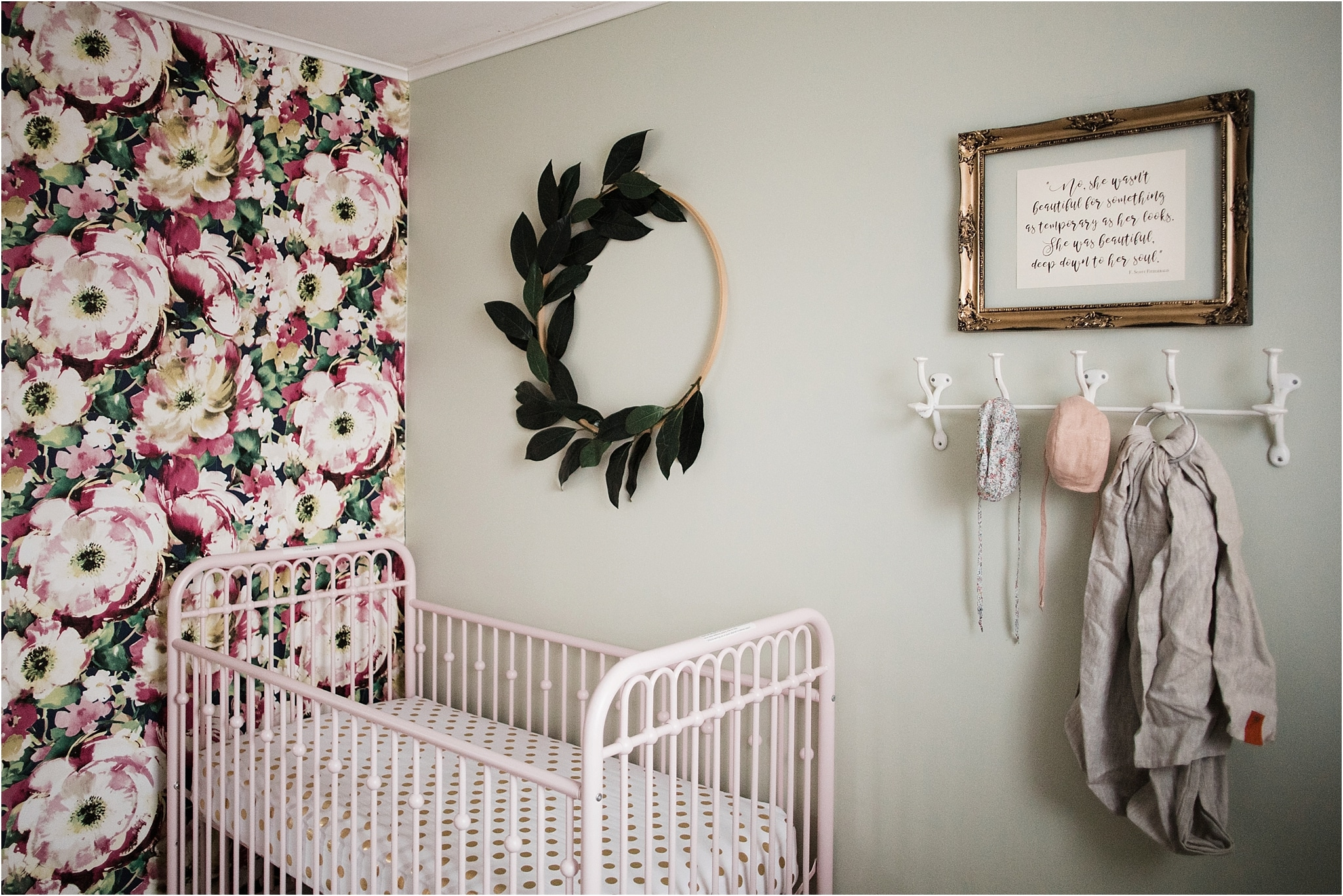 floral wallpaper and pink crib nursery