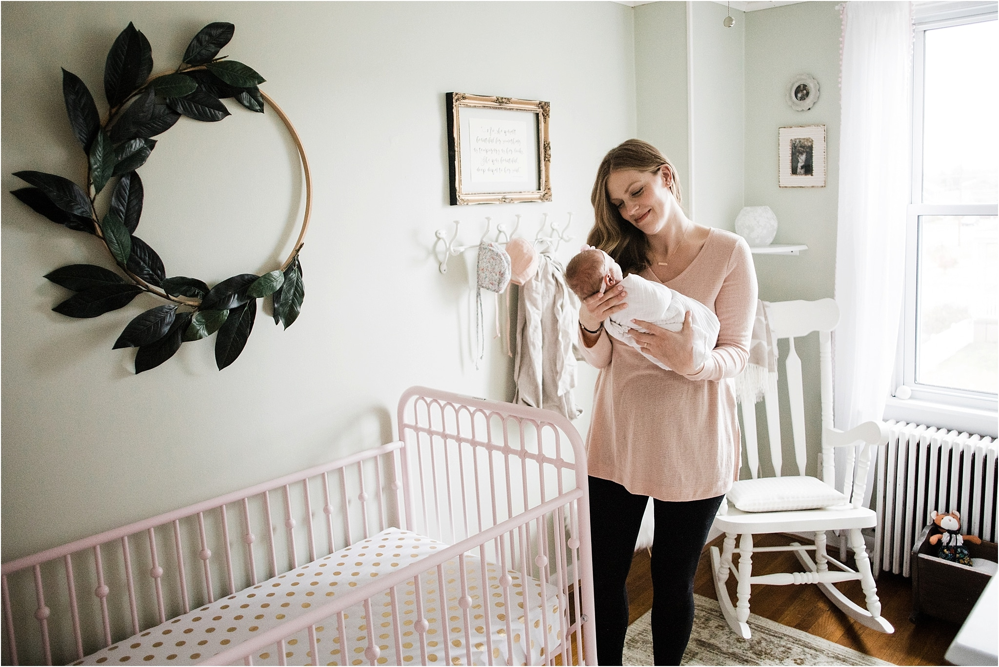 mother holding baby girl in beautiful nursery