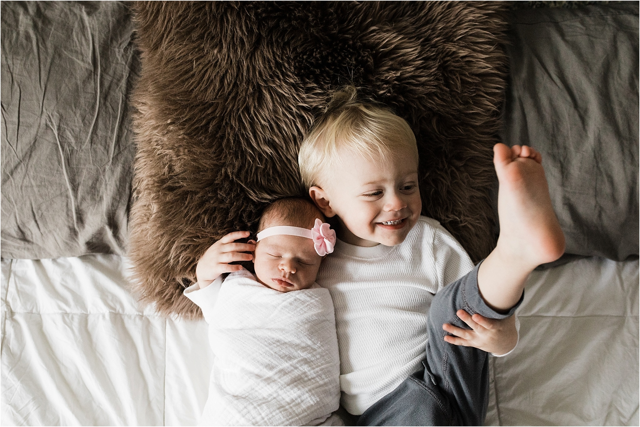 sibling photos in bedroom at newborn session at home