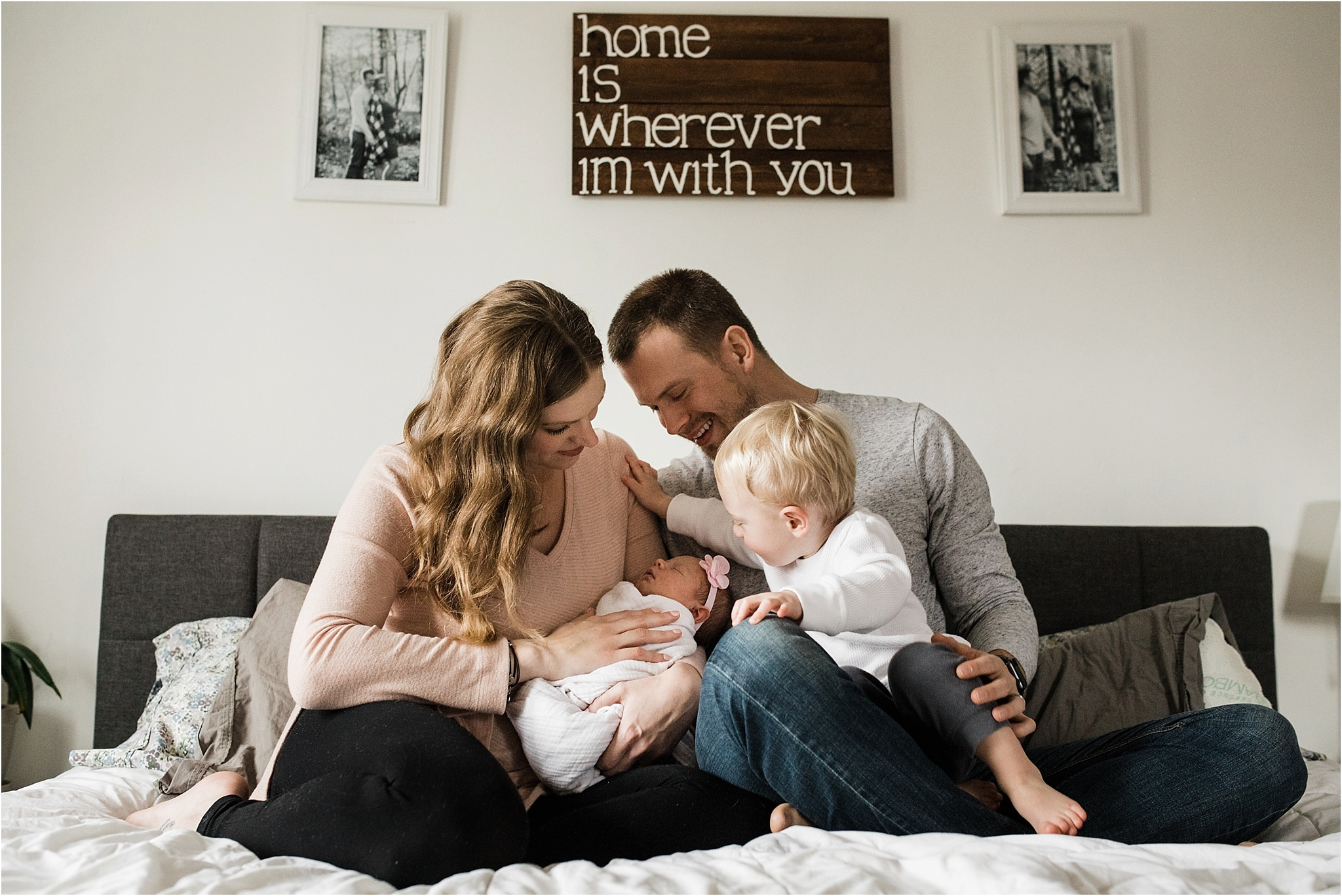 family photos in bedroom at newborn session at home