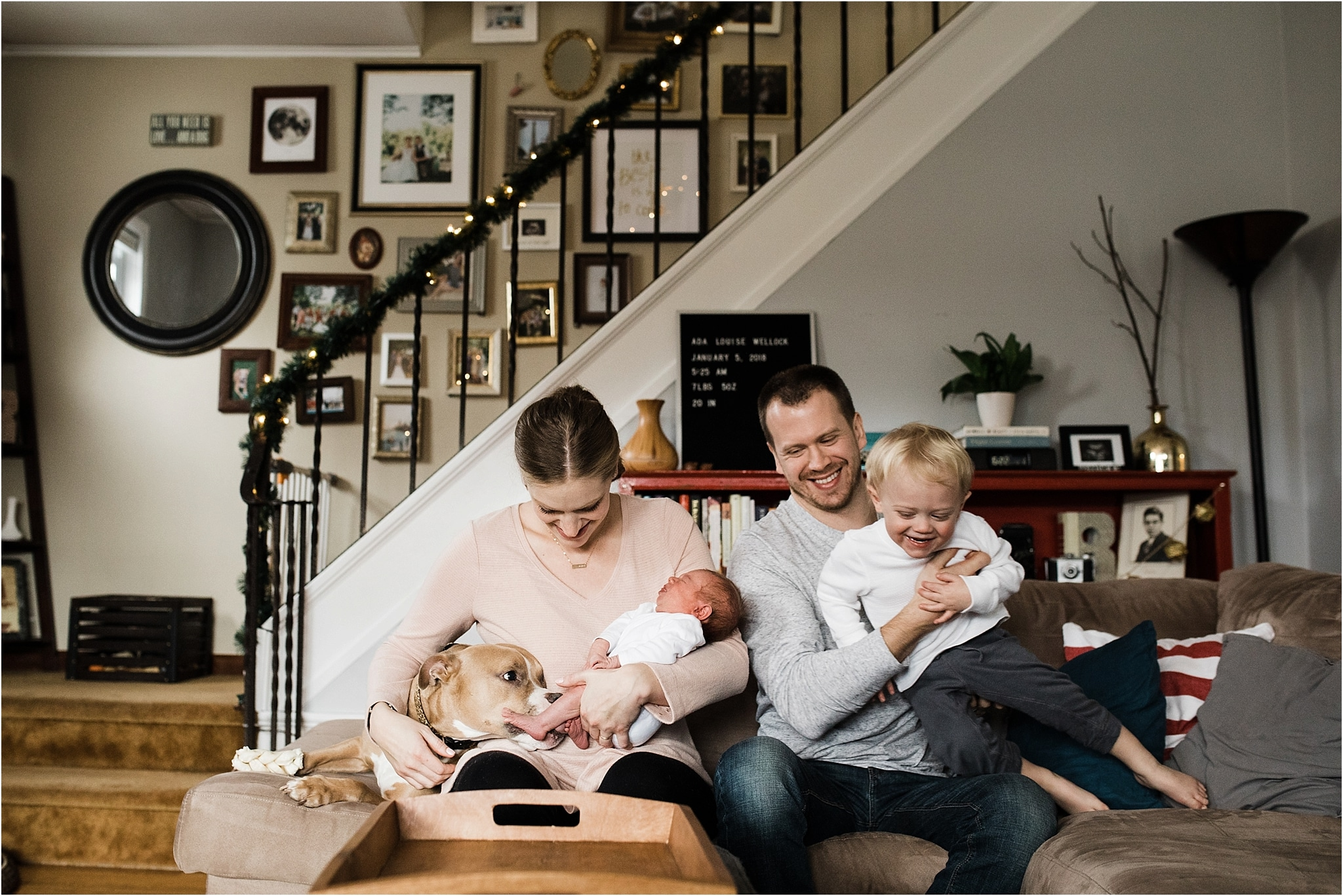 crazy family photo suring in home newborn session