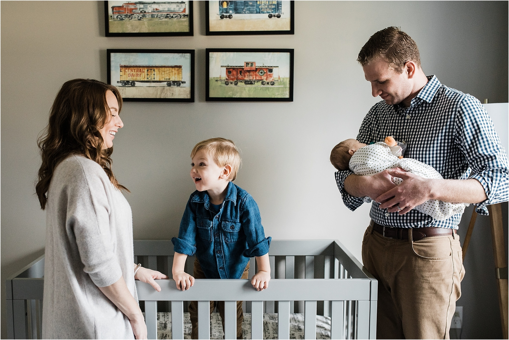 natural family photos in nursery during home newborn session