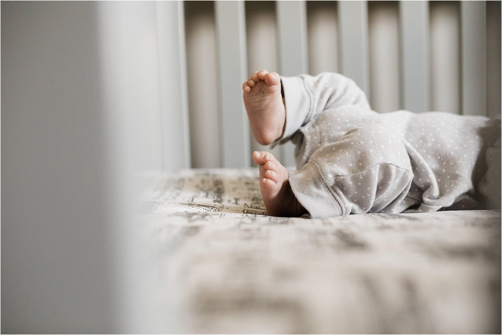 newborn toes peeking through crib