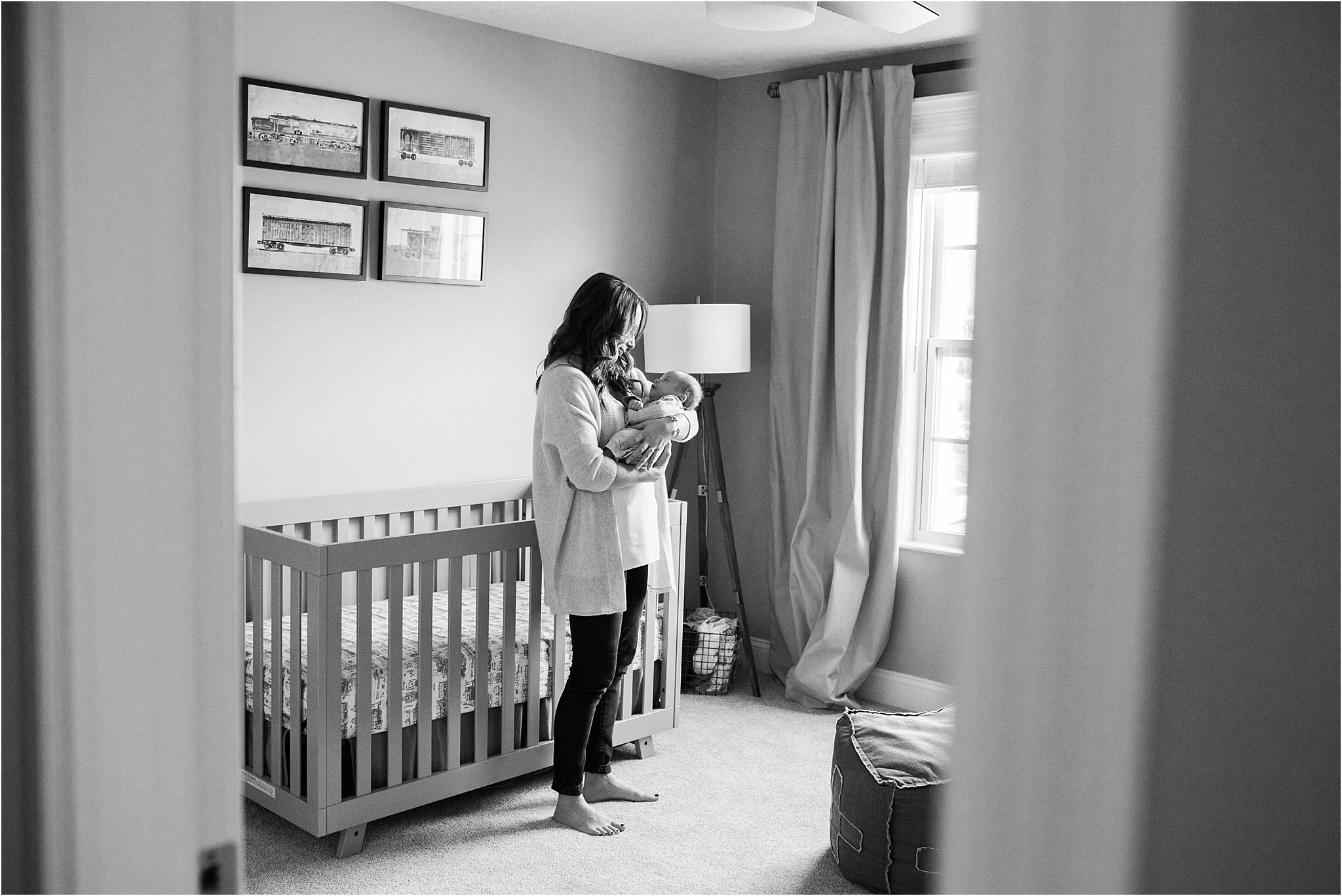 looking through doors at mother holding newborn baby