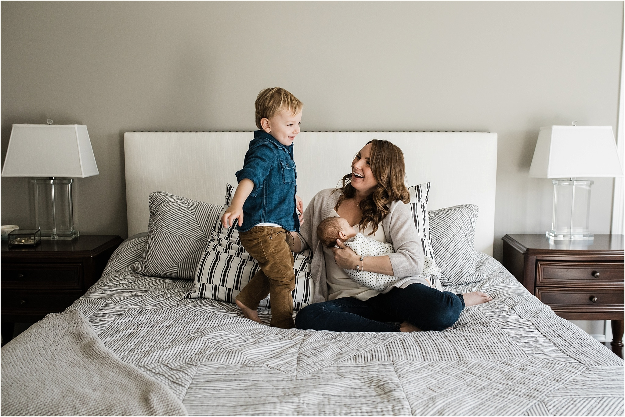 toddler having fun with mom and baby during home newborn session