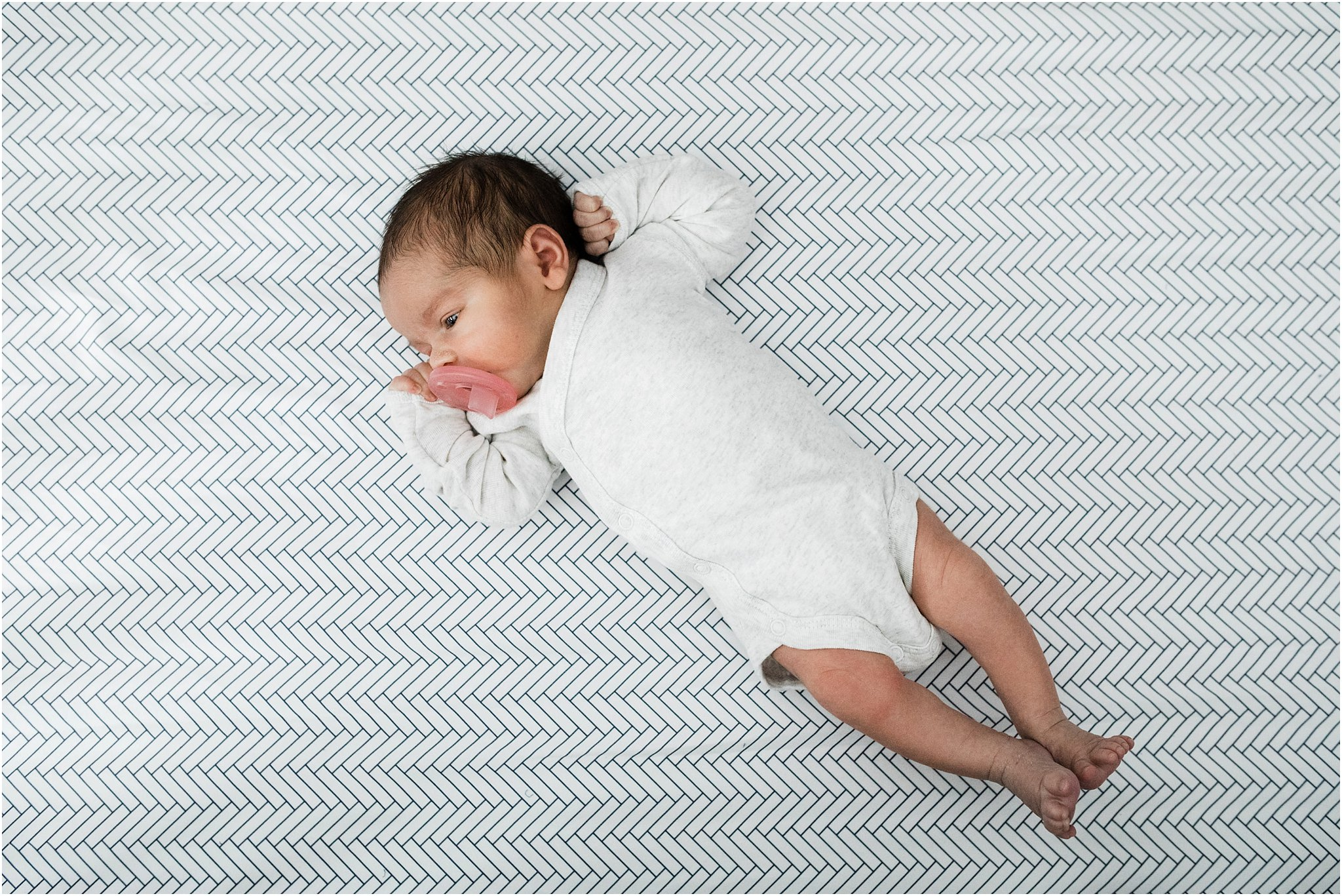 natural in home newborn photo with baby in crib