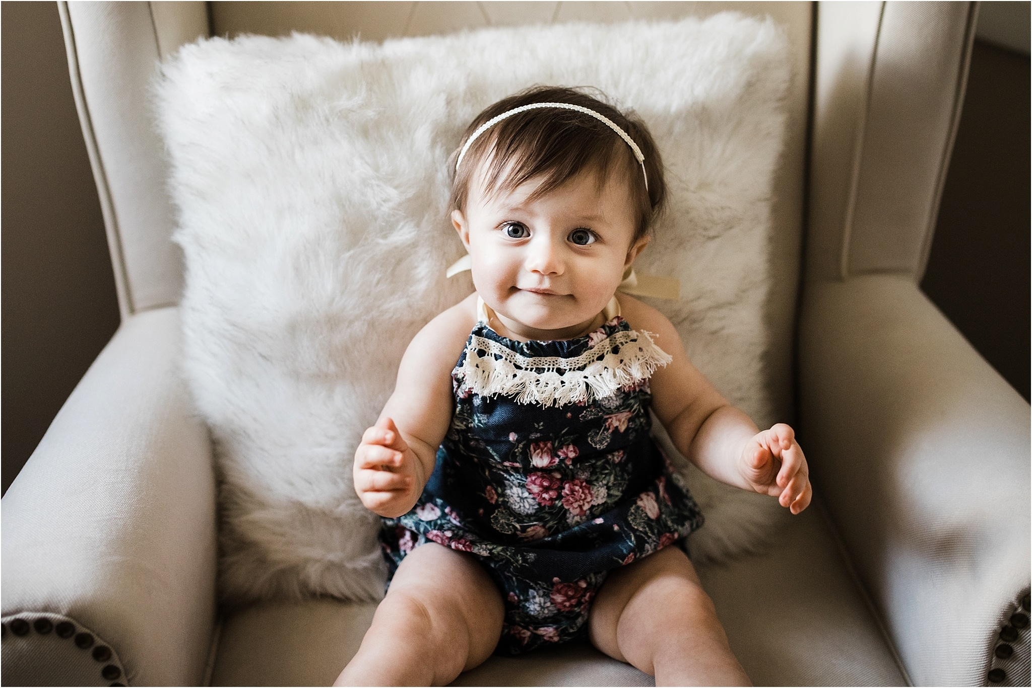 ONE YEAR OLD GIRL IN FLORAL ROMPER PHOTOS IN NURSERY