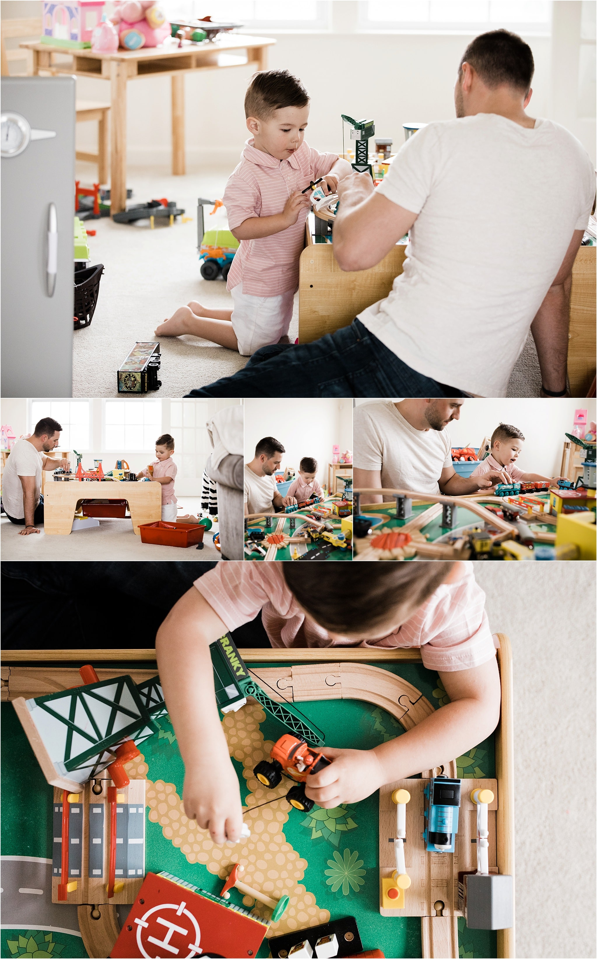 father and son playing with train table at home