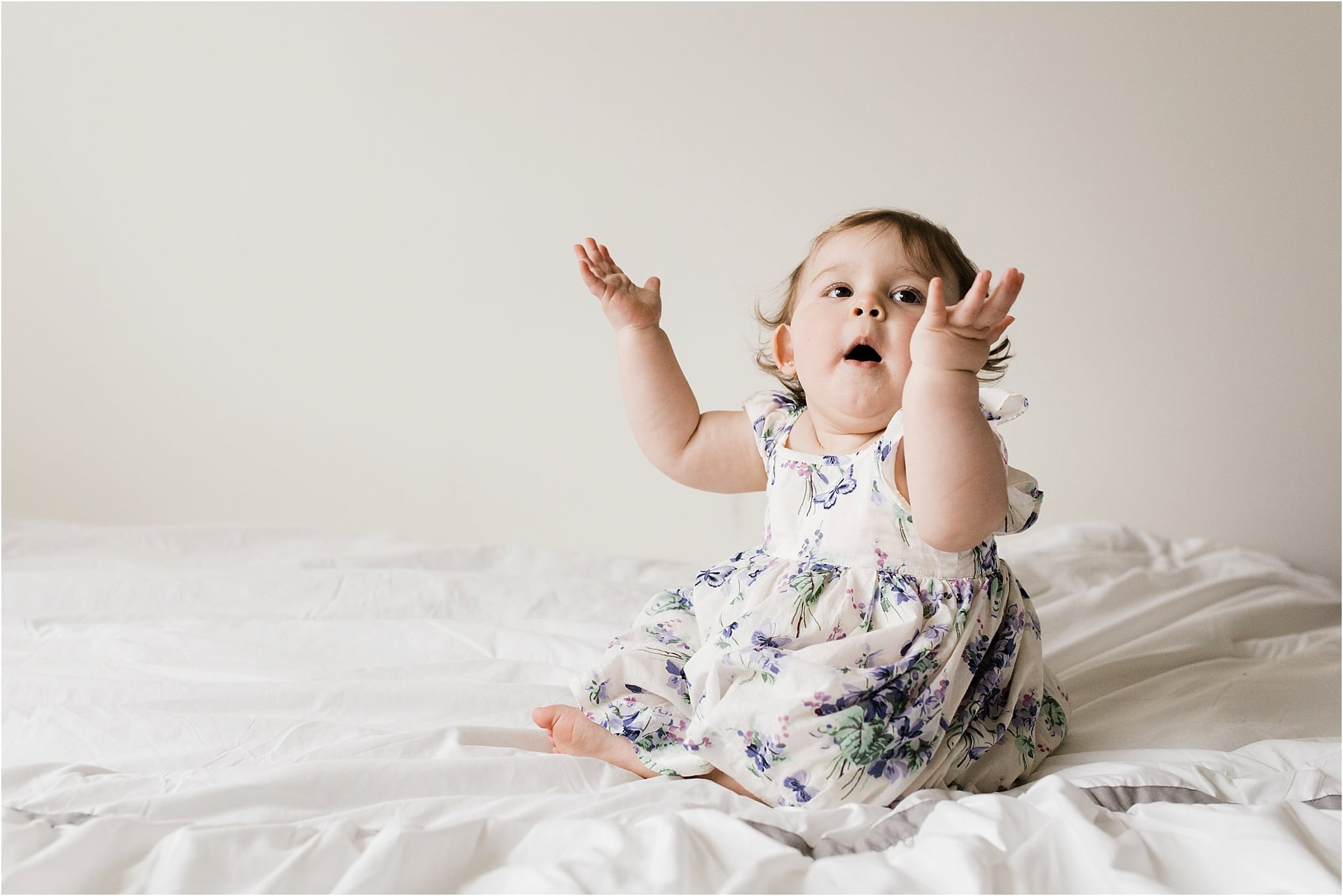 one year old girl in floral gap dress