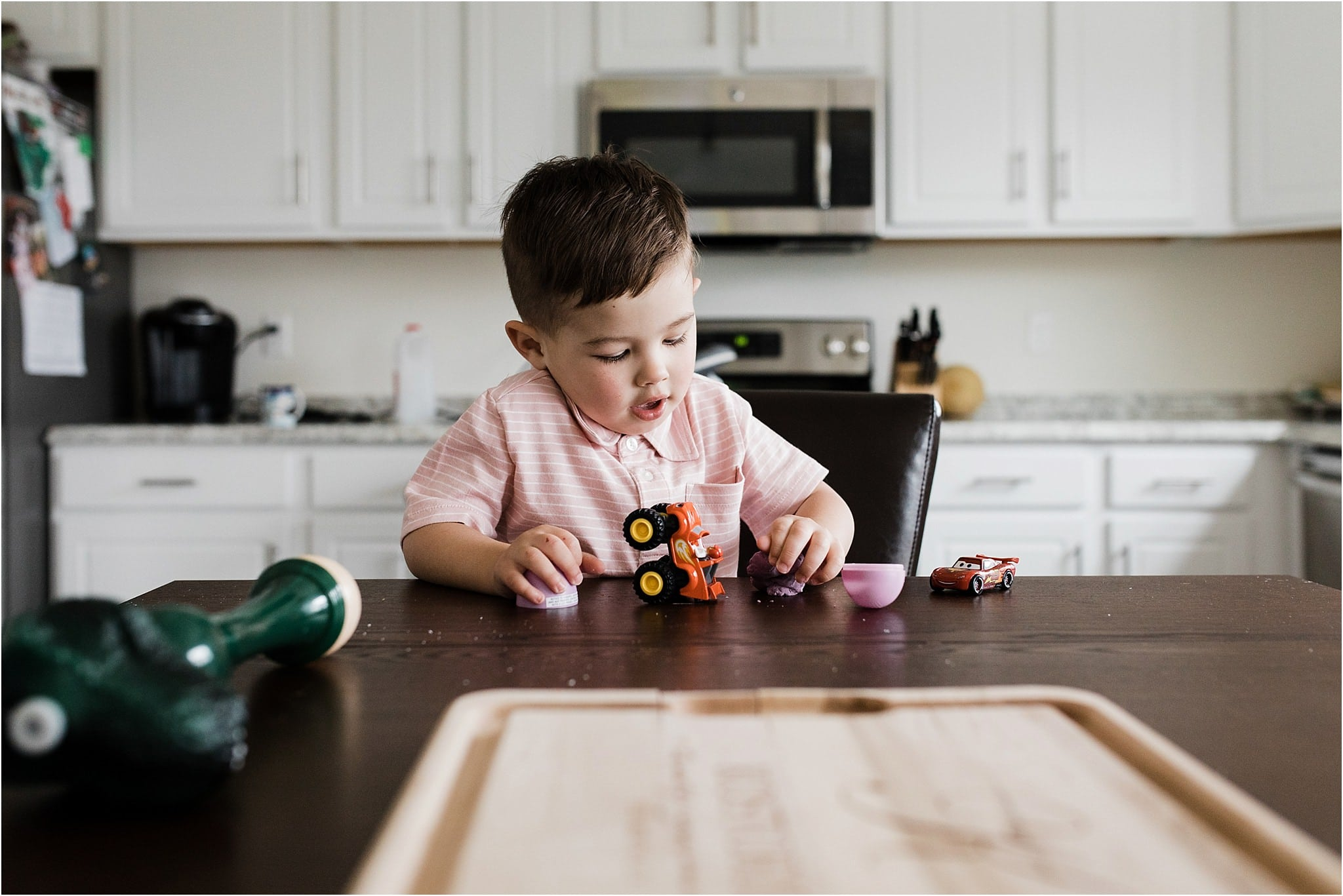 toddler boy playing at the kitchen table