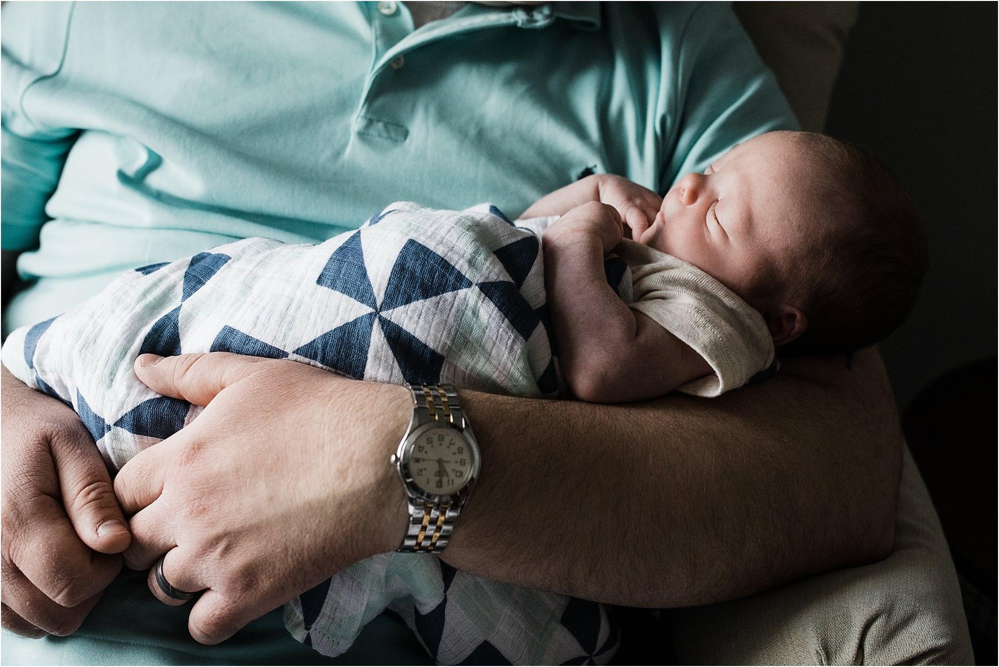 father holding newborn boy