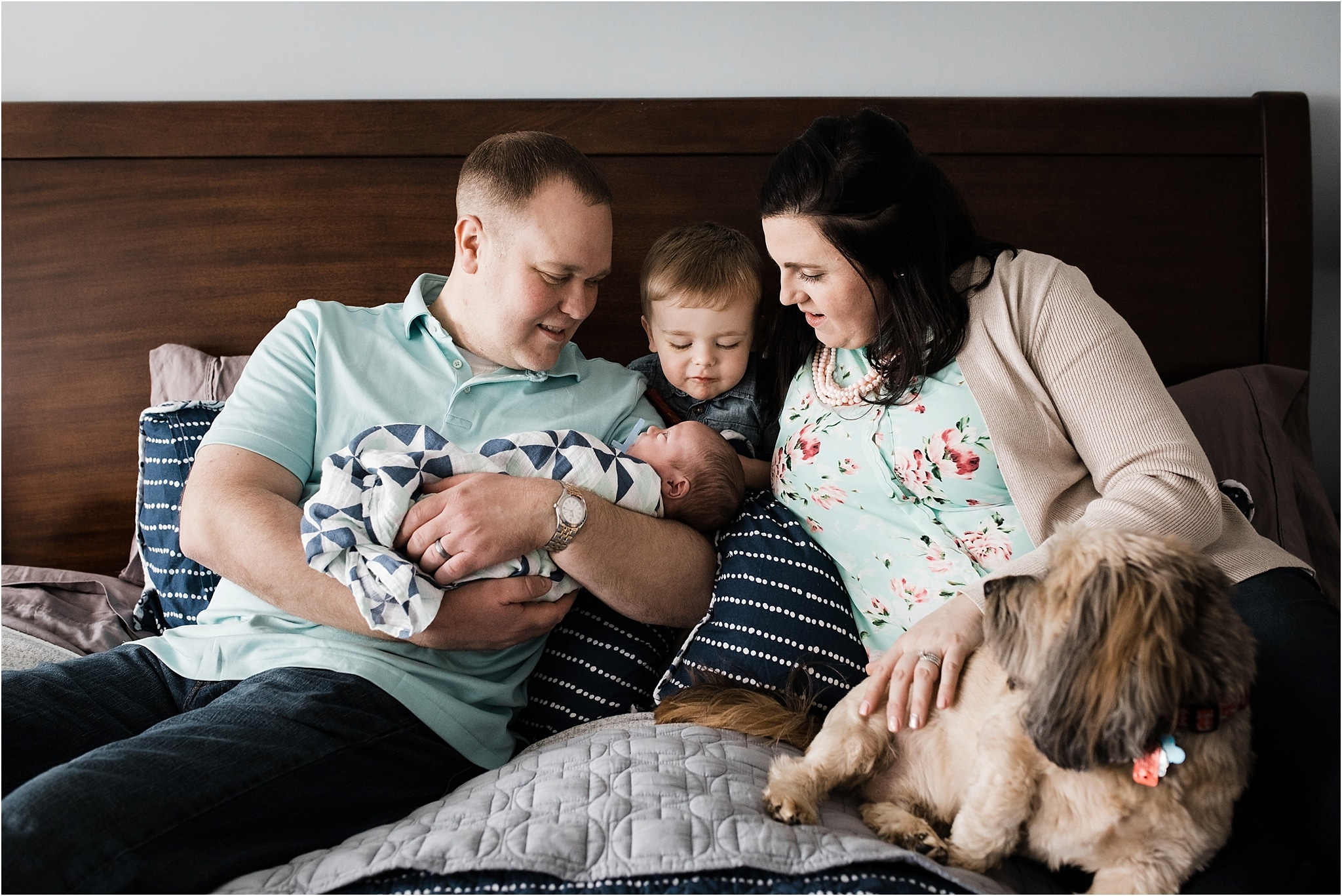 newborn session family photo on bed